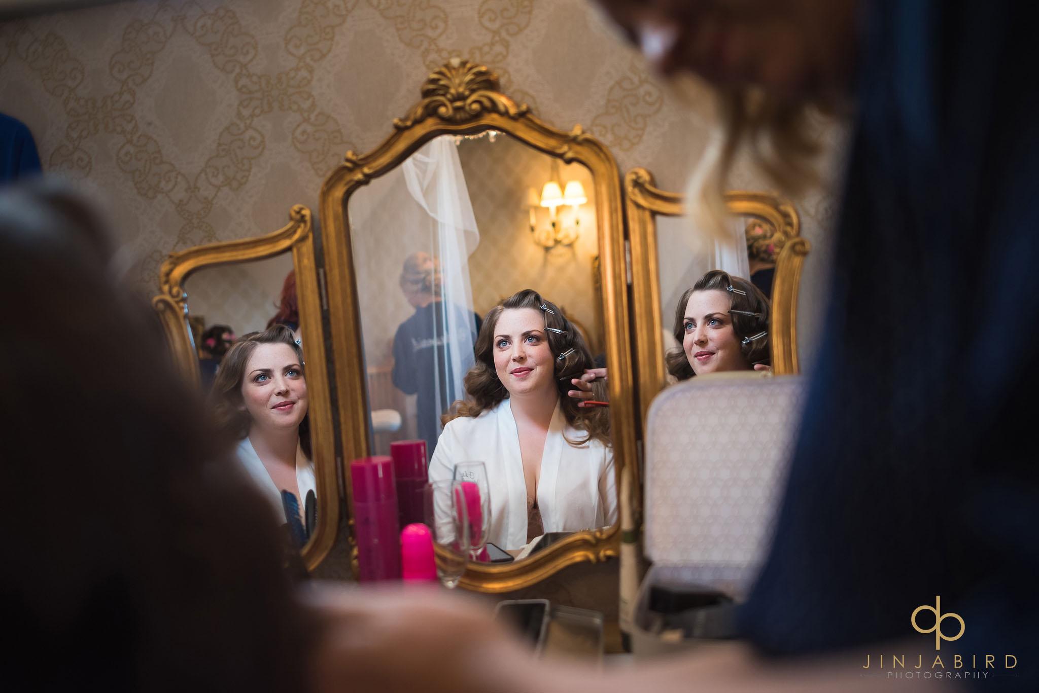 bride in mirror getting ready bassmead manor