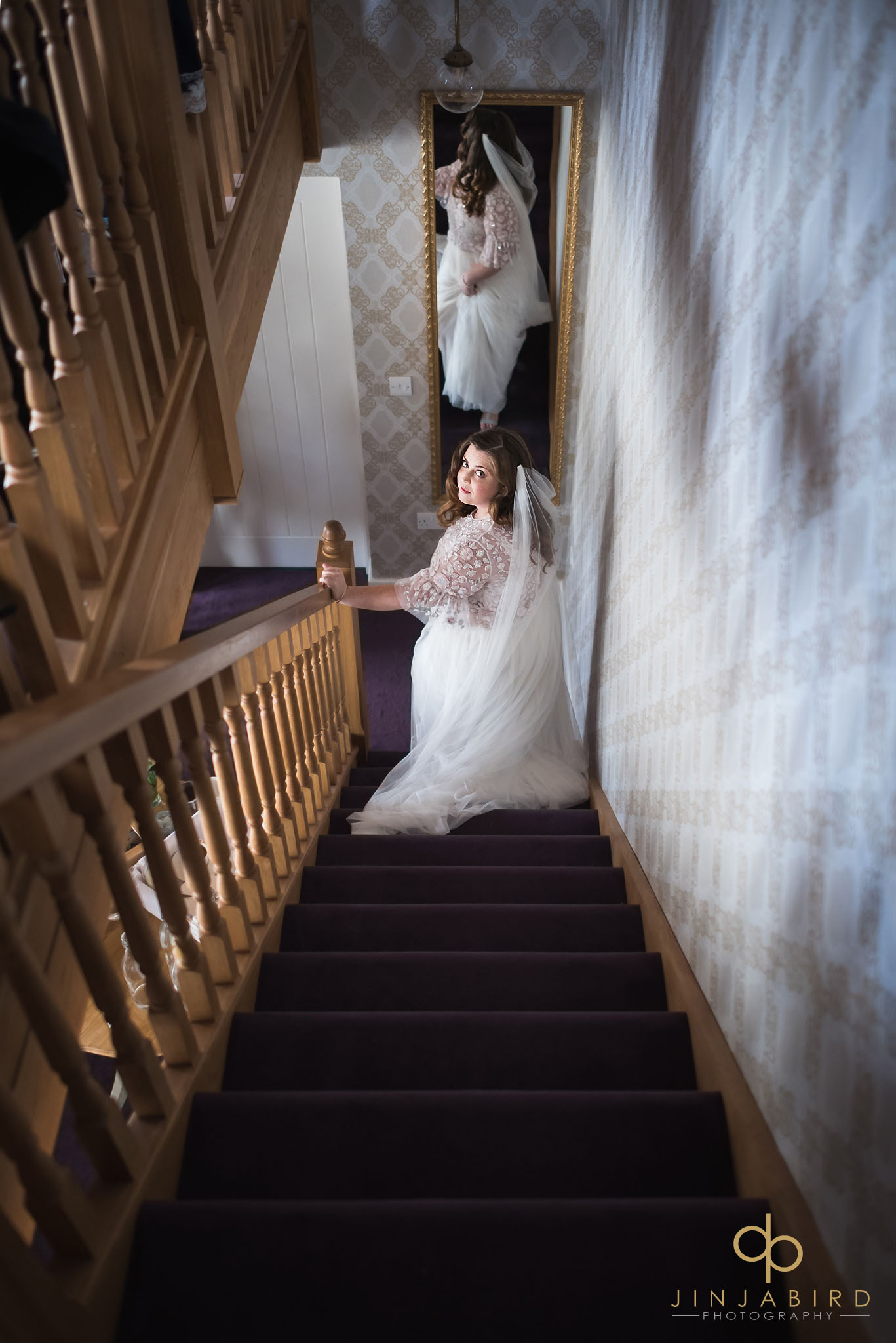 bride on stairs in boudoir bassmead manor