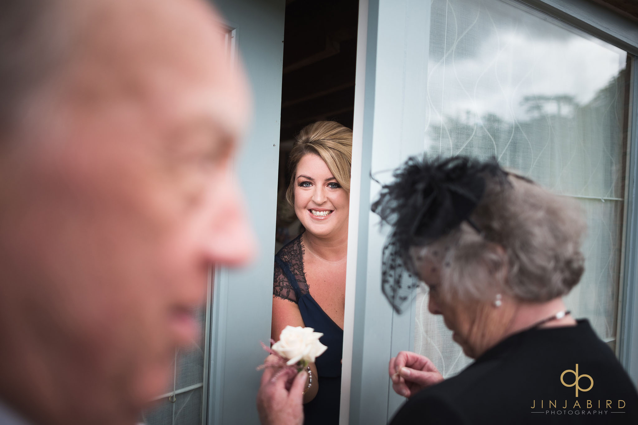 bridesmaid peeping out of door