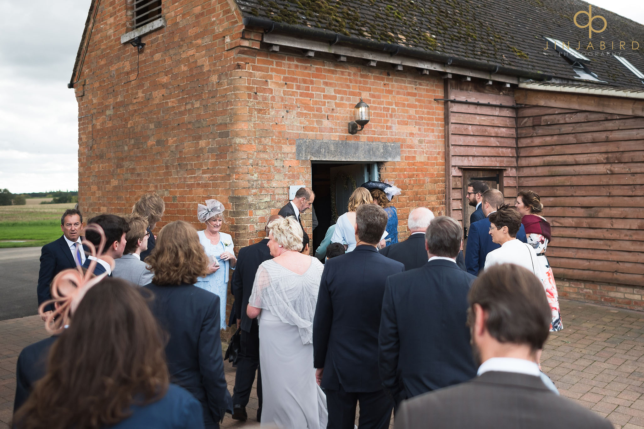 wedding guests entering the rickety barn bassmead
