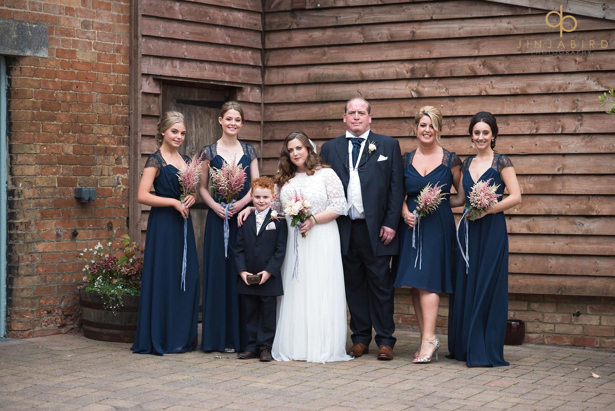 bridal party outside rickety barn bassmead