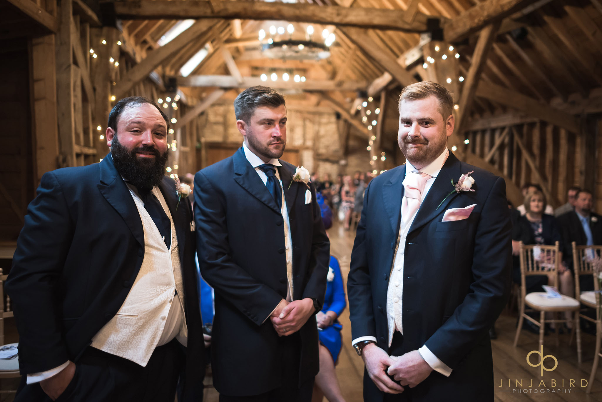groom waiting for bride with best men