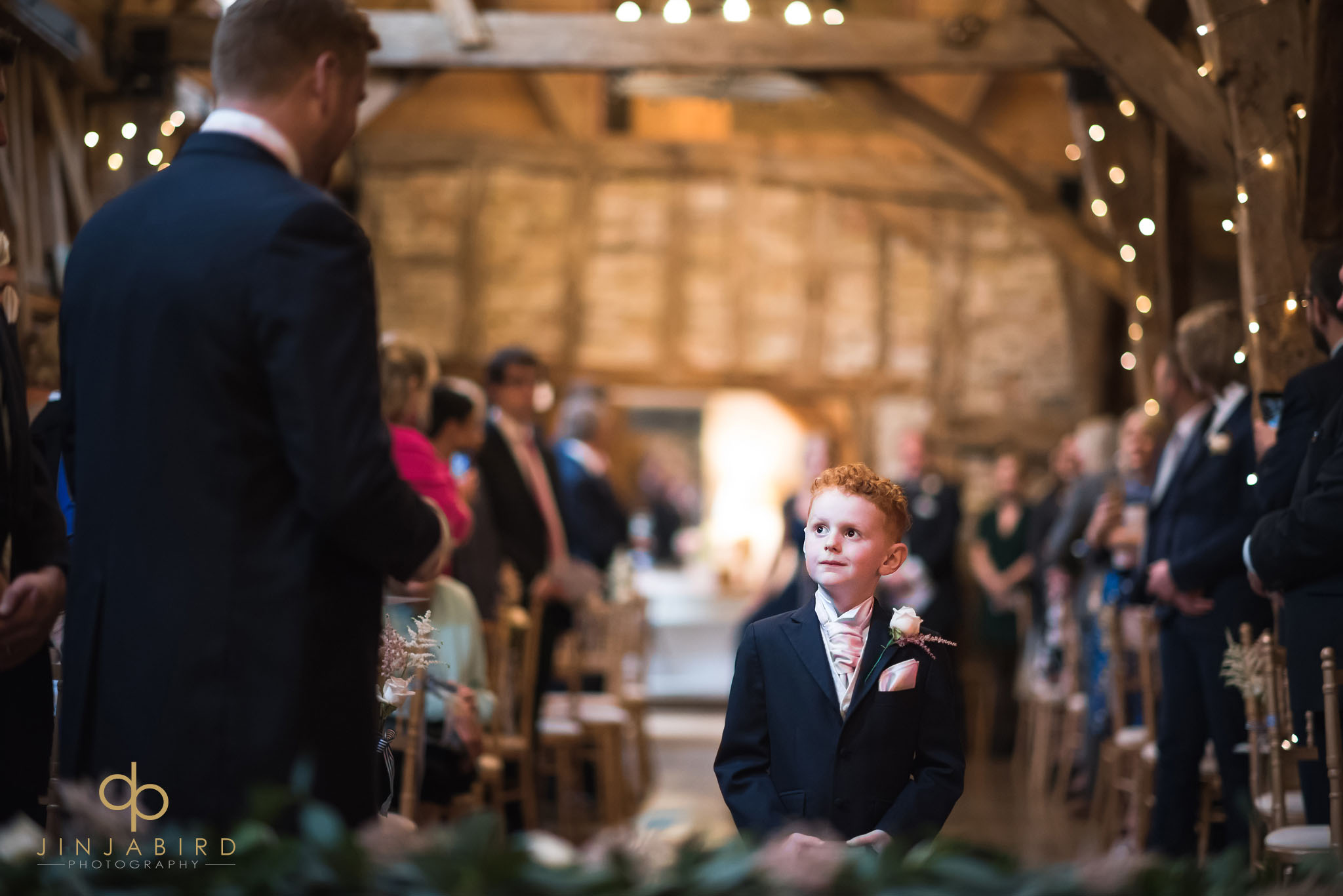 pageboy coming down aisle in rickety barn bassmead