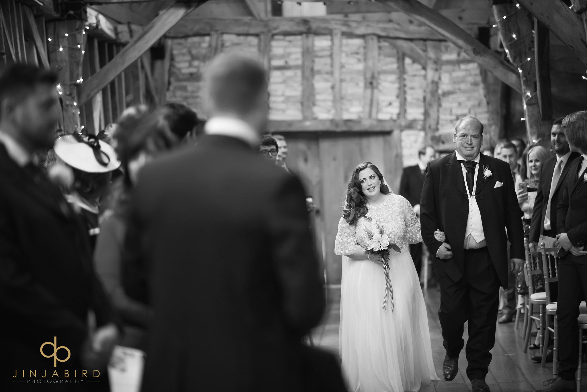 bride with father coming down aisle rickety barn bassmead