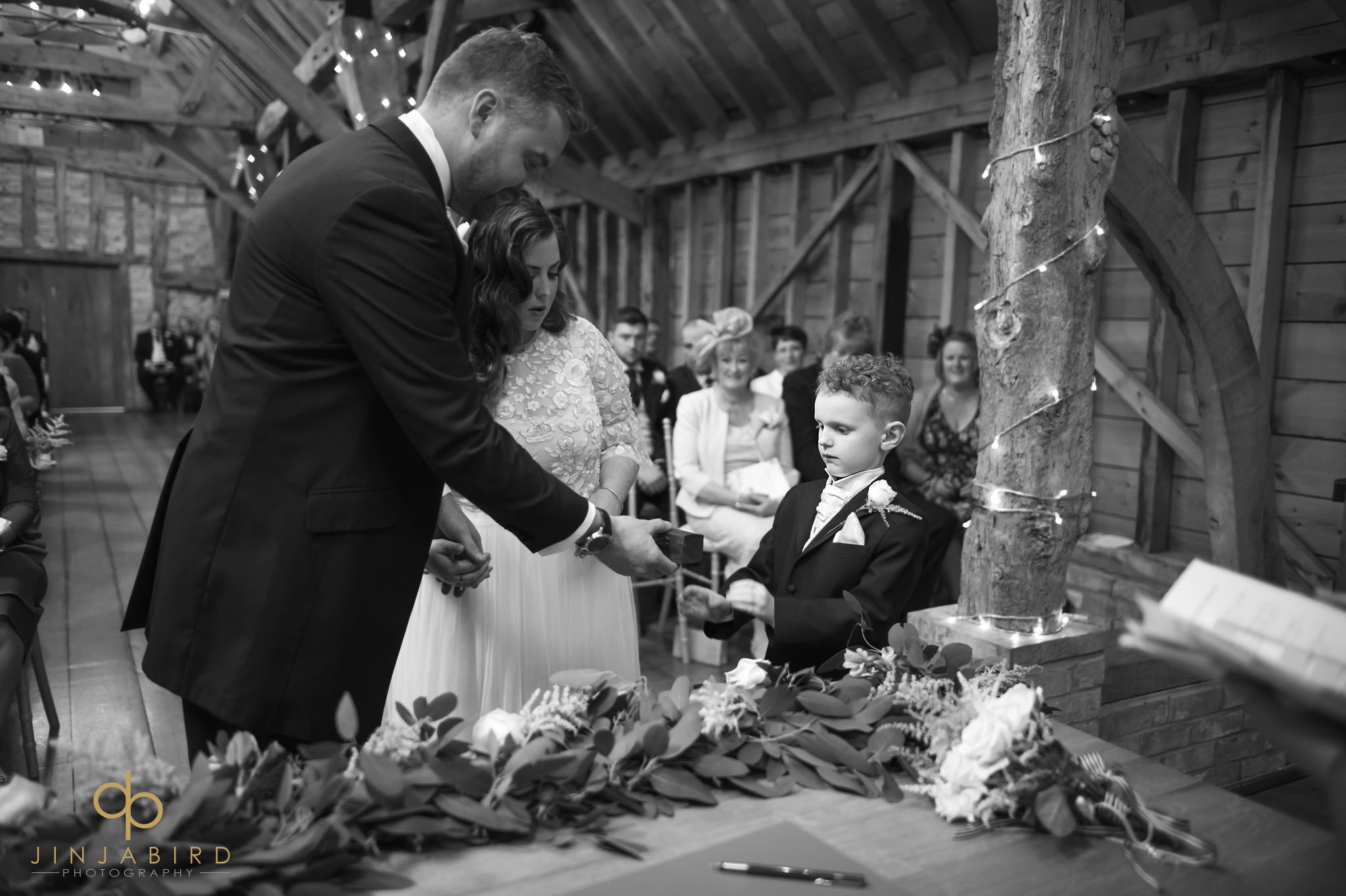 pageboy giving rings to groom