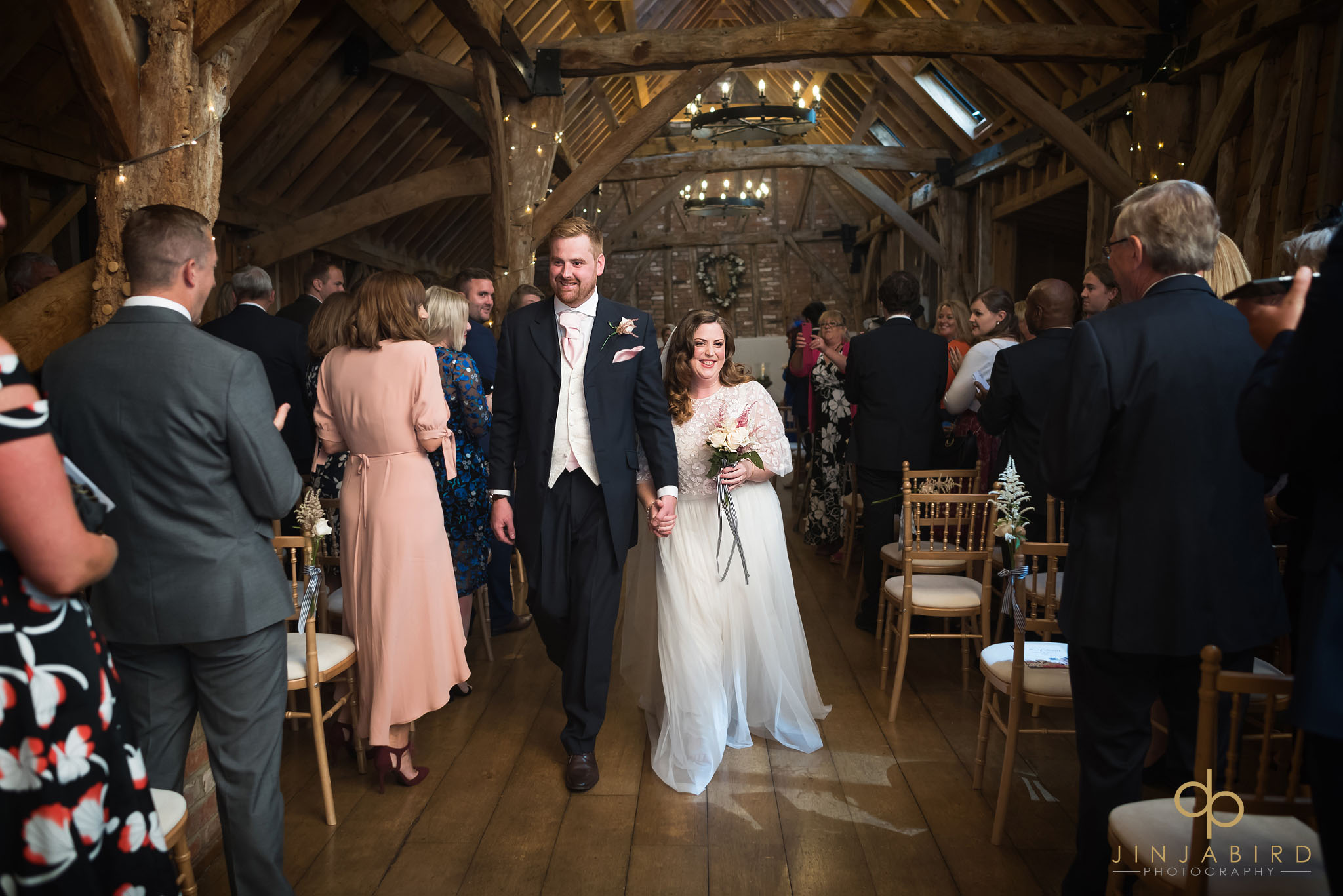 bride and groom come down aisle rickety barn bassmead