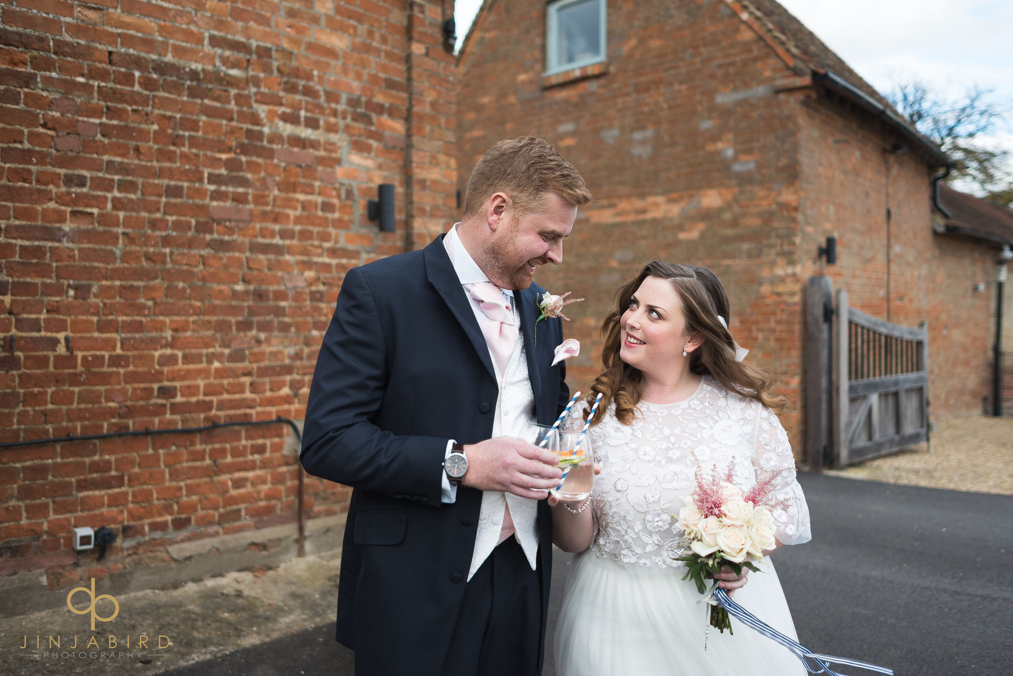 bride and groom outside rickety barn bassmead manor