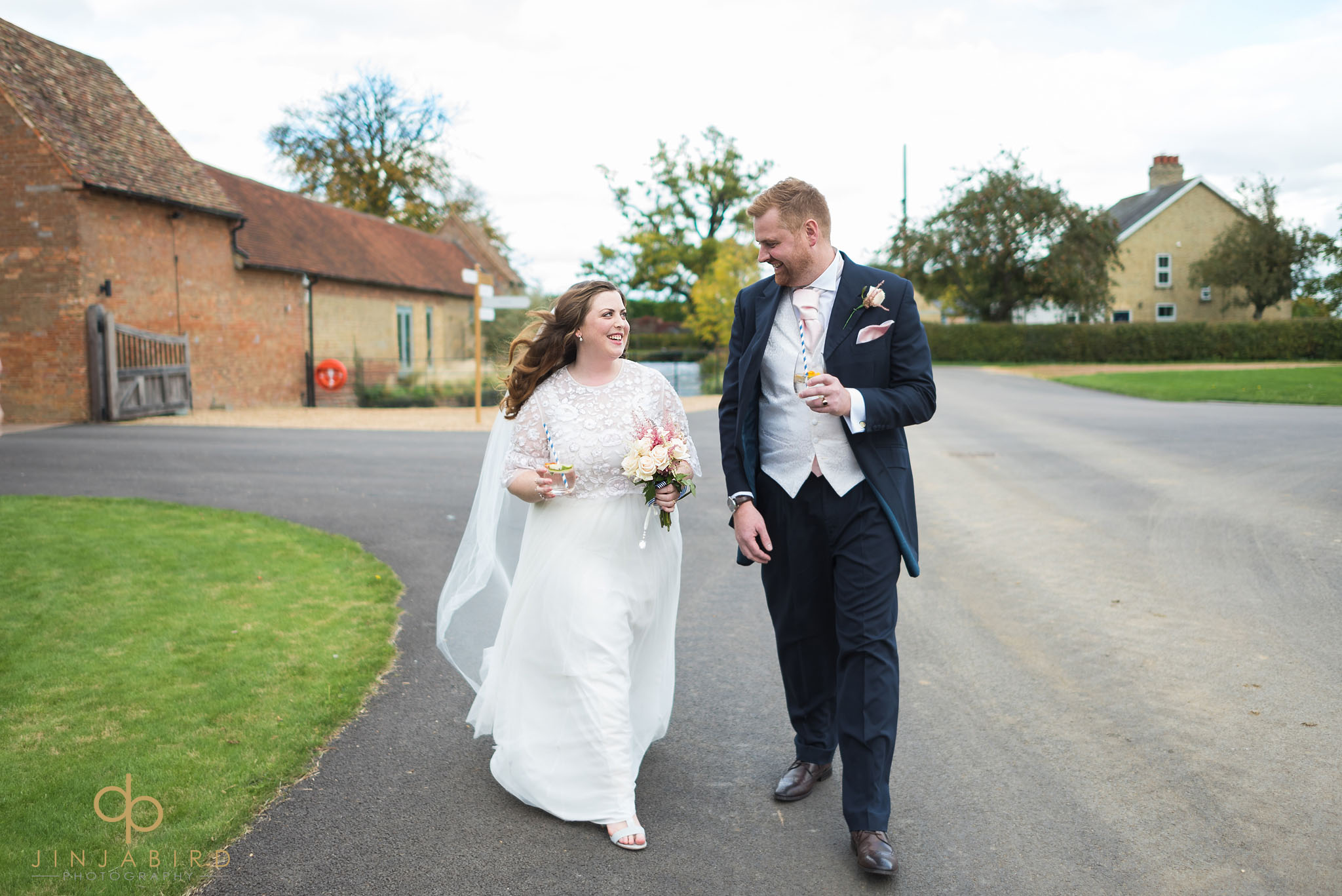 bride and groom walking along drive bassmead manor