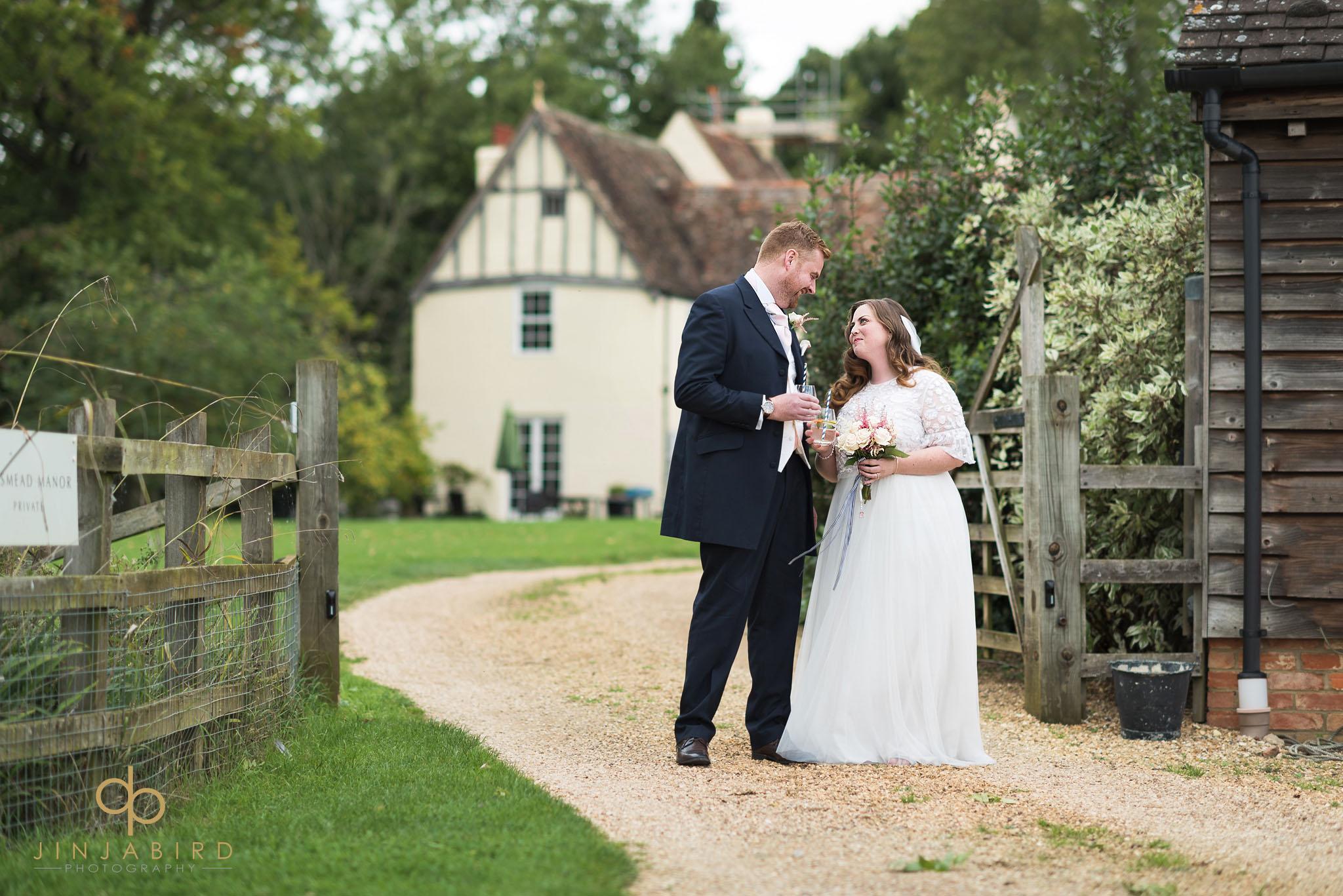 bride and groom outside bassmead farm