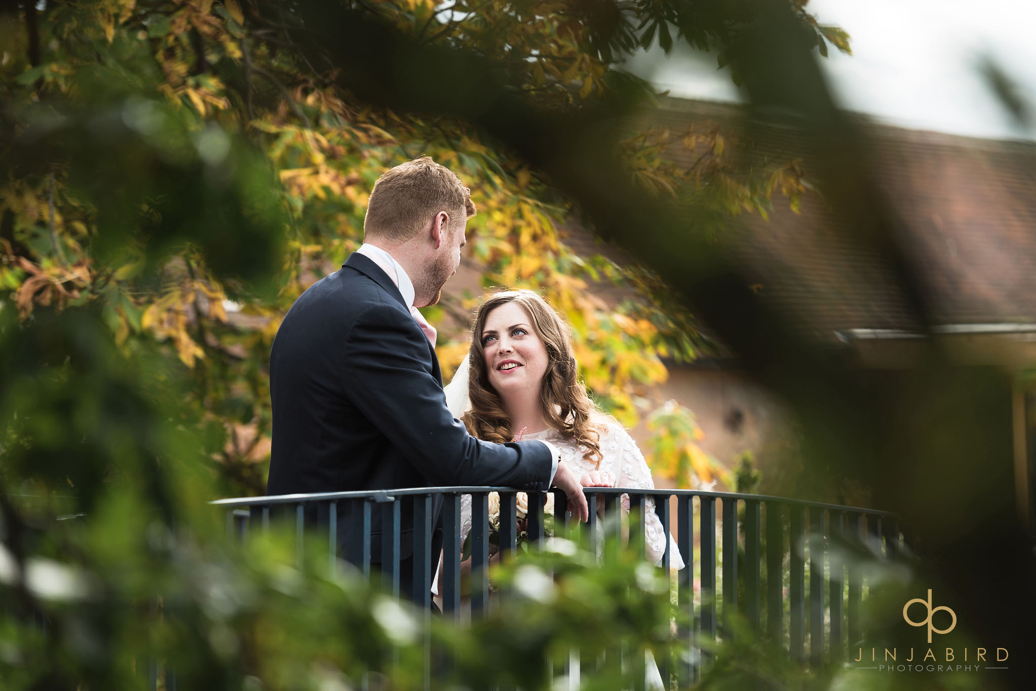 bride and groom on bridge bassmead manor