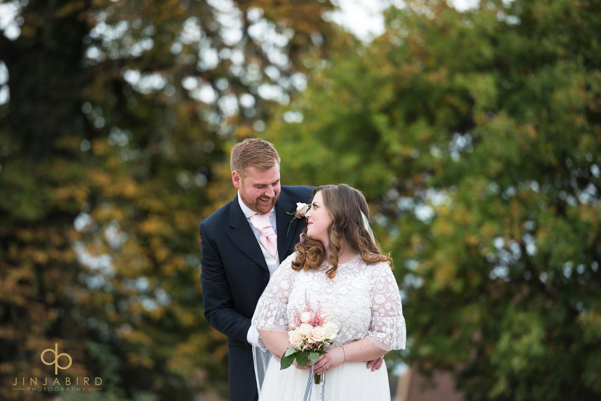bride and groom in woods bassmead manor