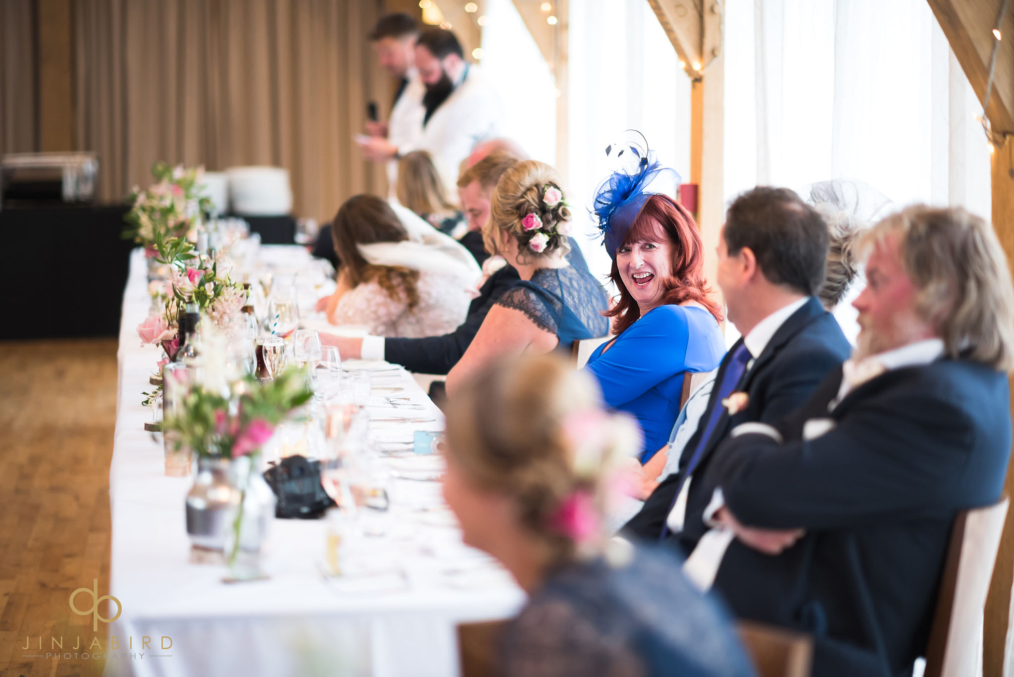 mum laughing during wedding speeches