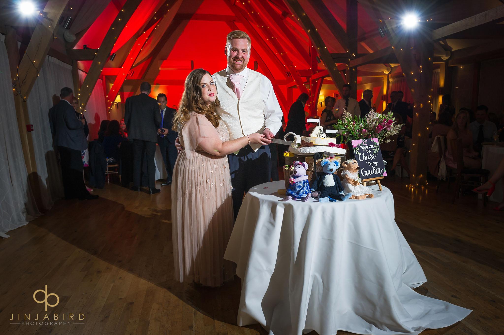 bride and groom cutting wedding cake bassmead manor
