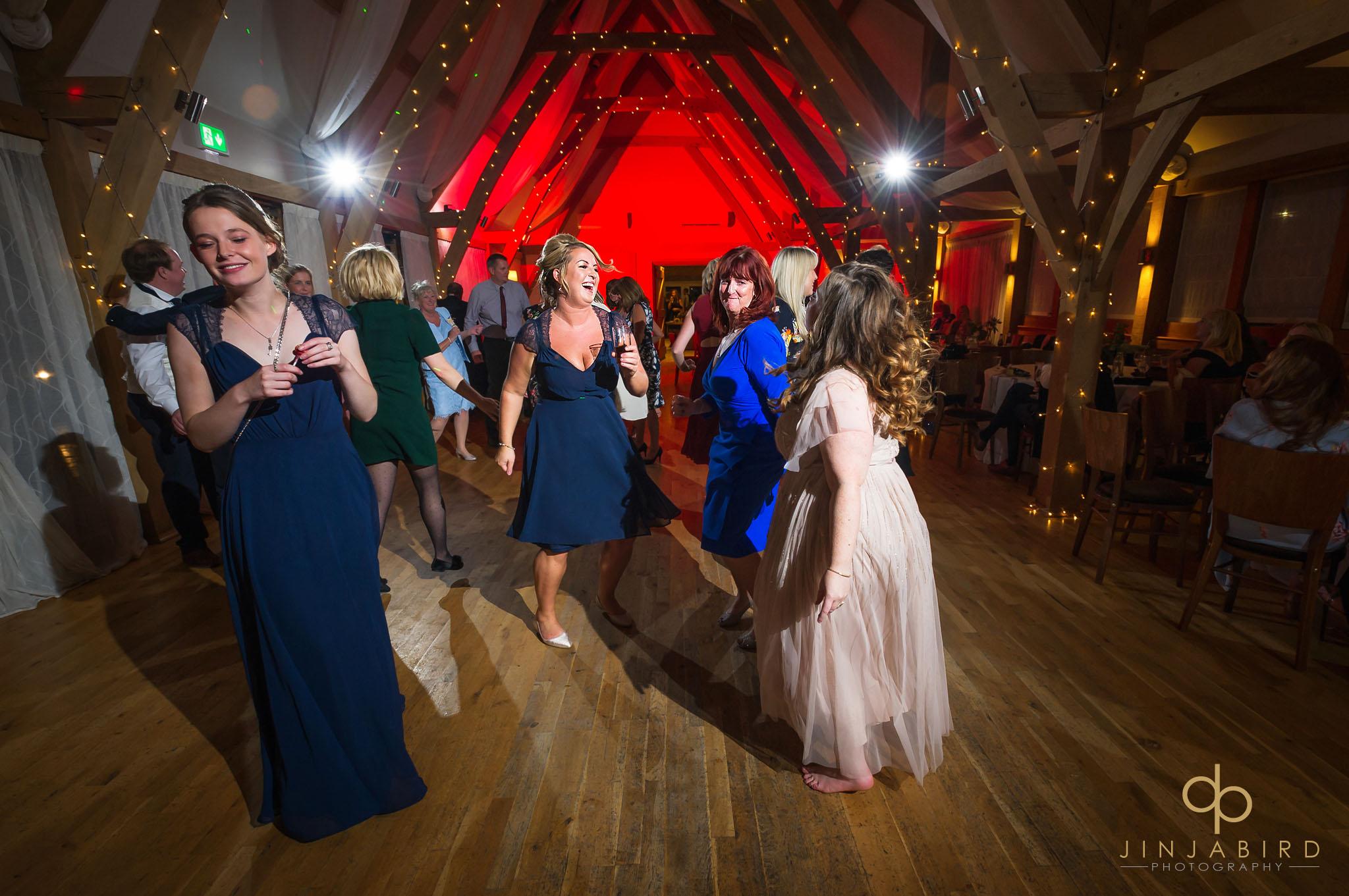 bride dancing with bridesmaids bassmead