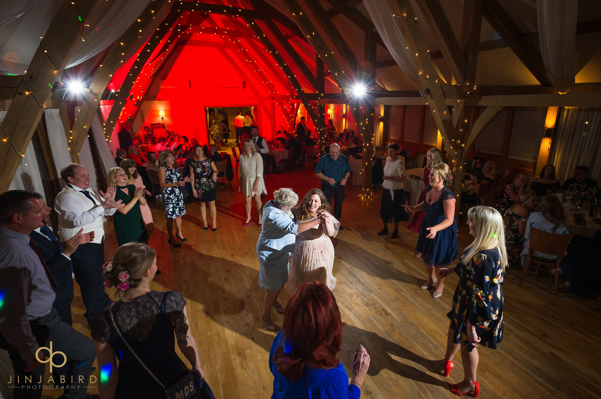 bride dancing with guests at bassmead manor