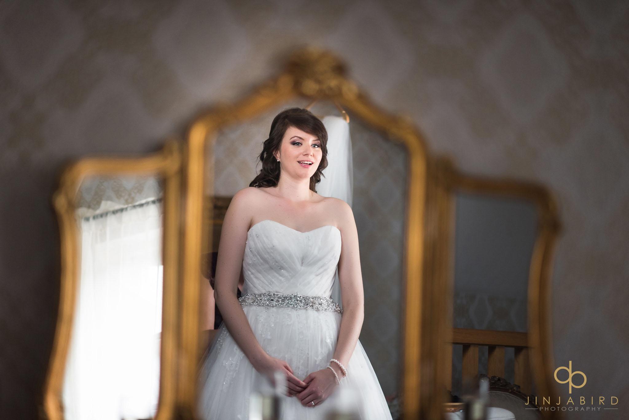 bride looking in mirror getting ready bassmead manor