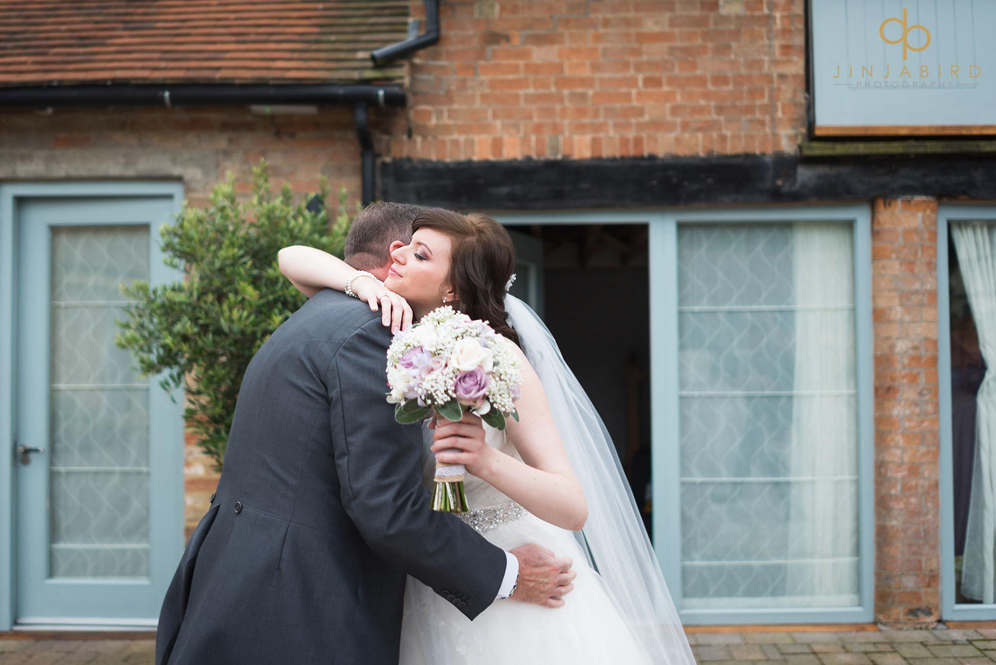 bride hugs dad