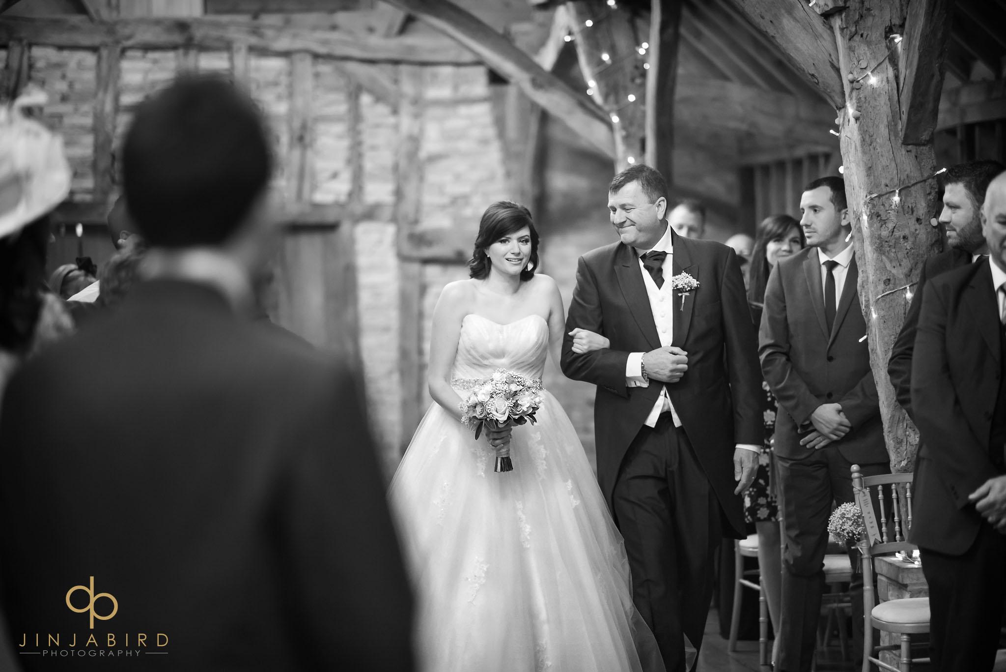 bride coming down aisle rickety barn bassmead manor