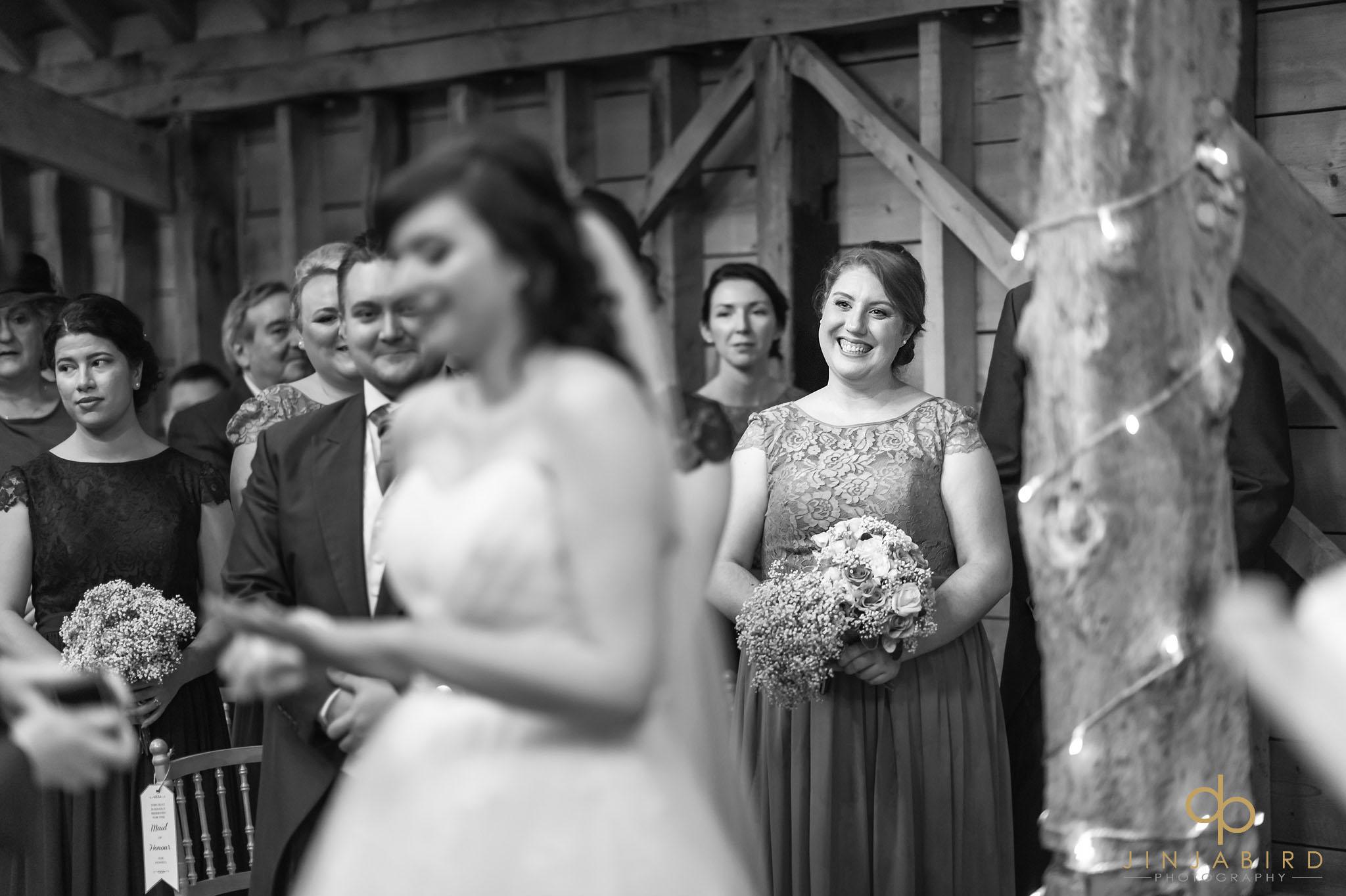 bridesmaid watching wedding ceremony
