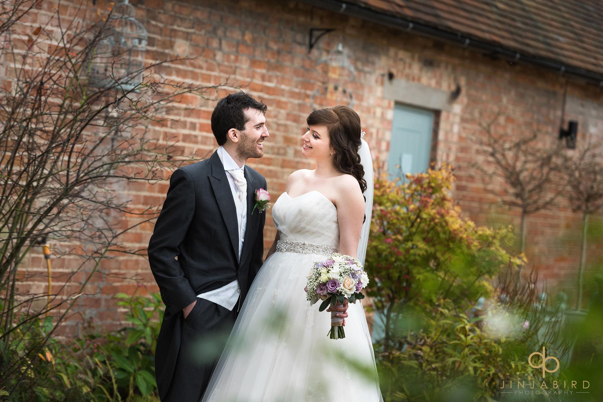 bride and groom talking in garden bassmead manor