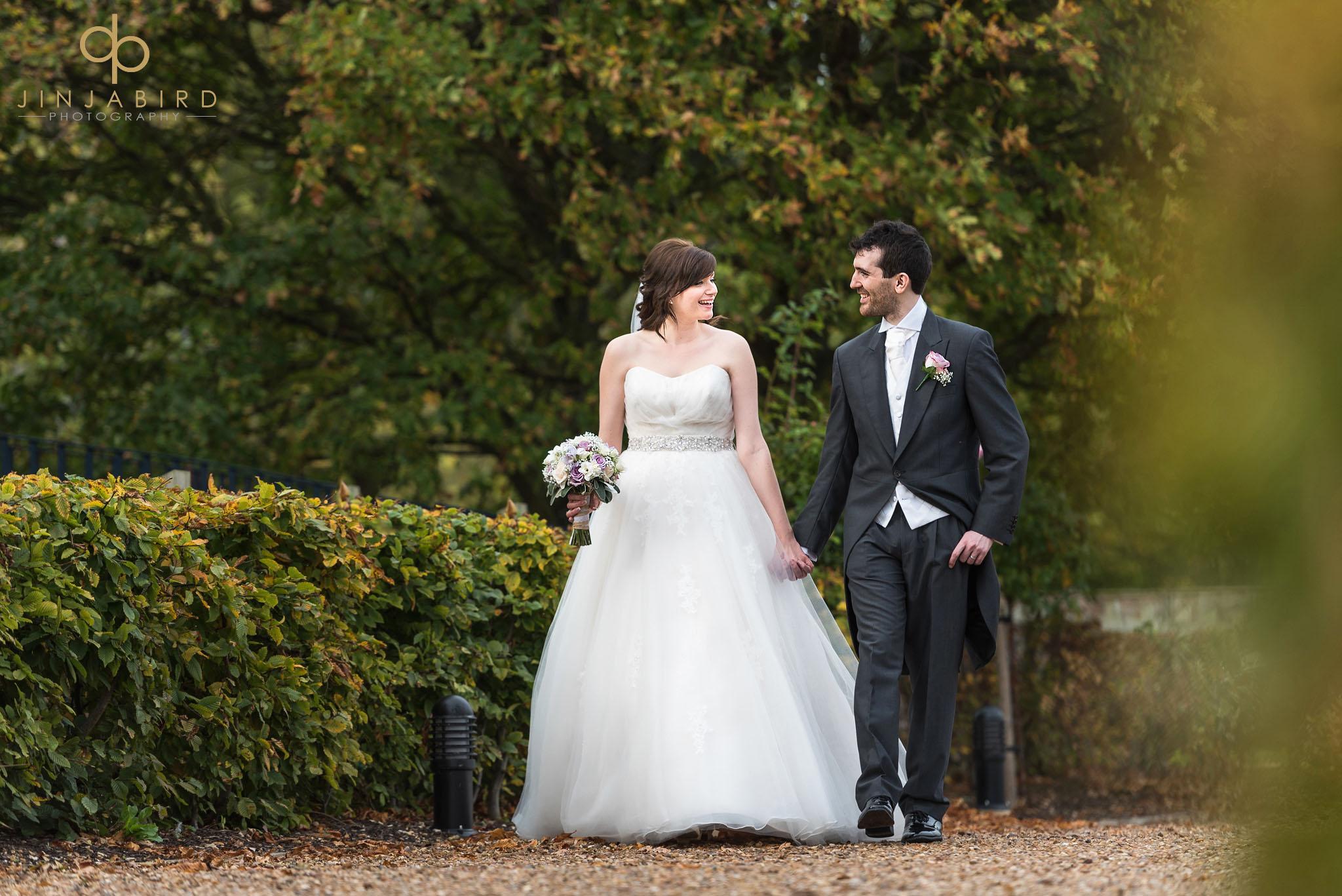 bride walking with groom in garden bassmead manor