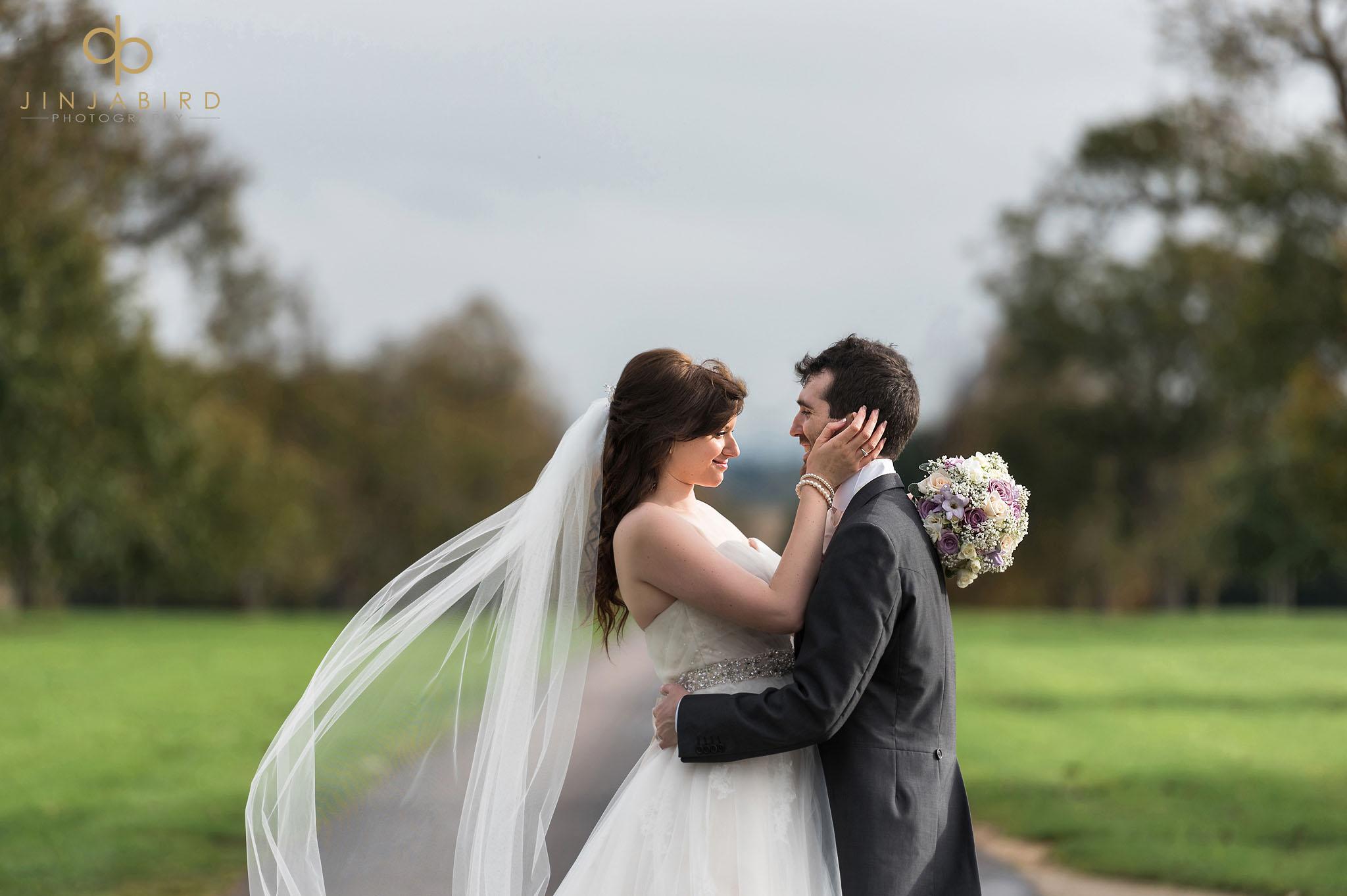 bride loving groom on driveway bassmead manor