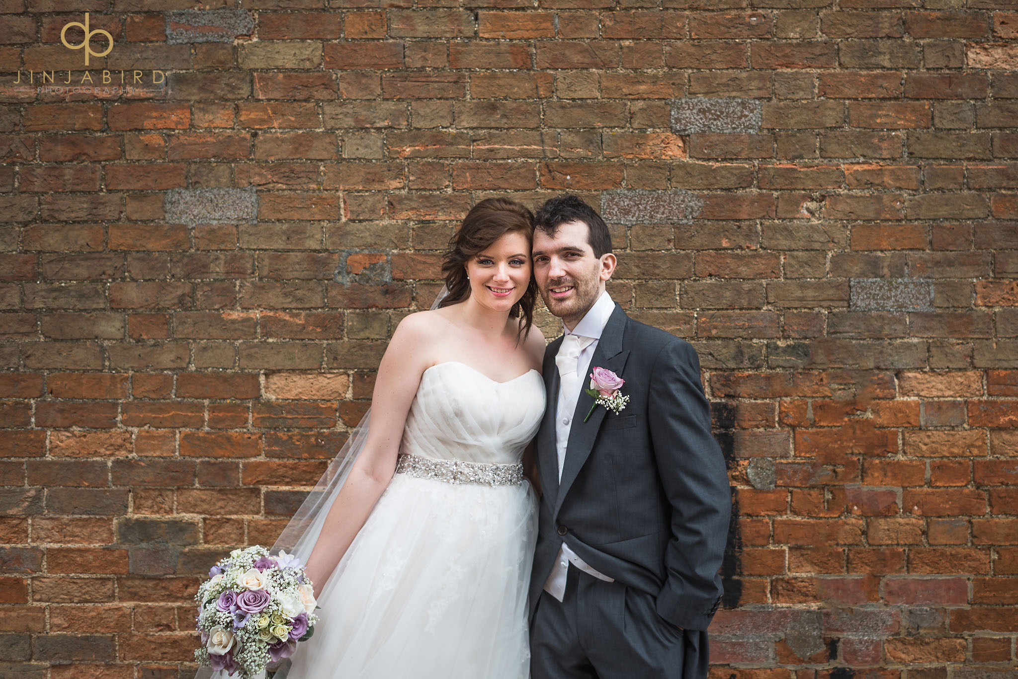 bride and groom outside rickety barn bassmead manor