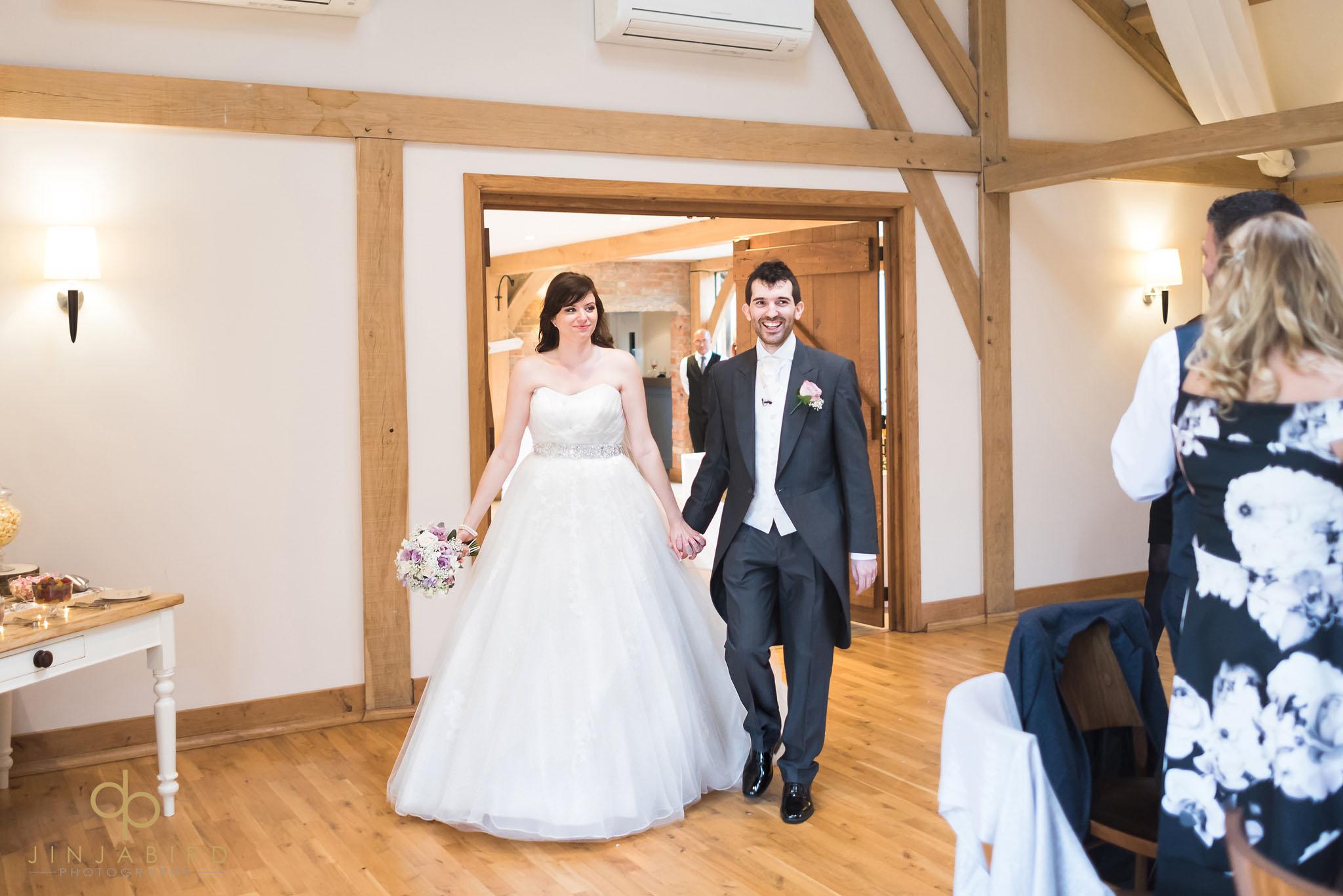 bride and groom make entrance at wedding breakfast