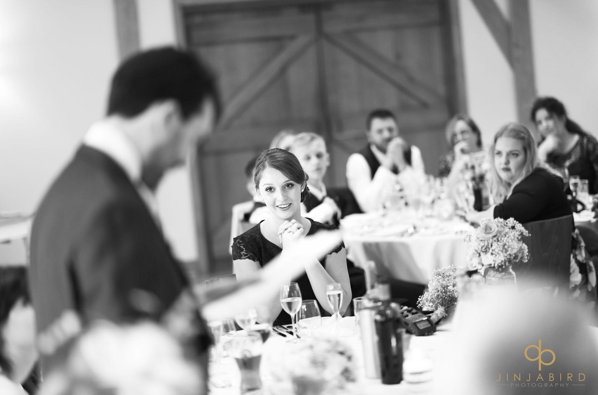 bridesmaid listening to grooms speech