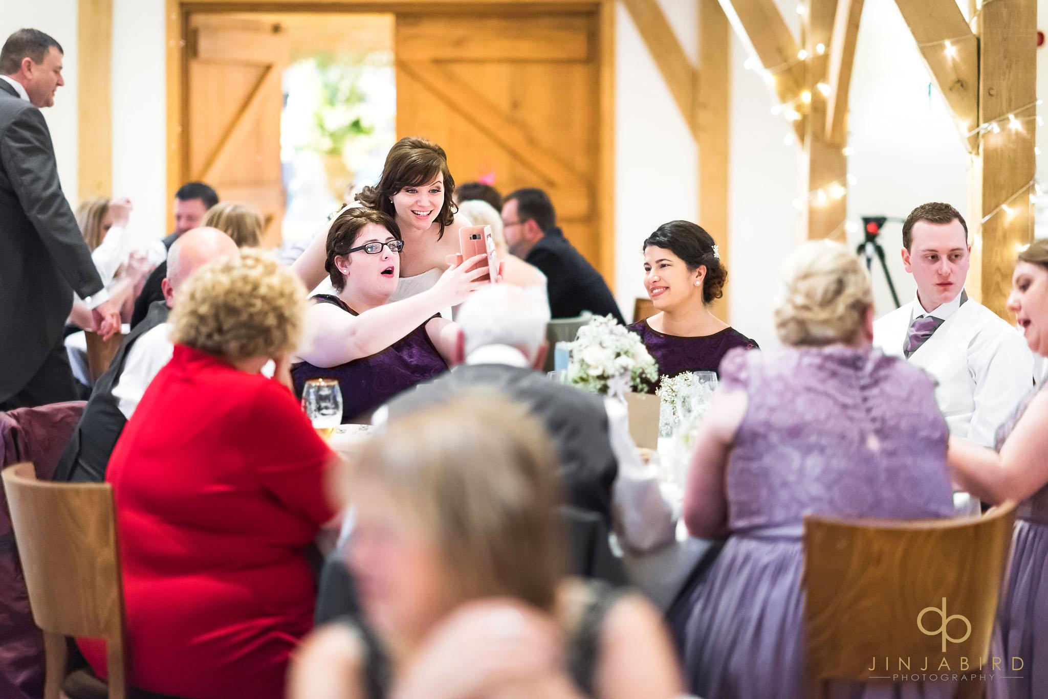 bride during wedding breakfast with bridesmaid