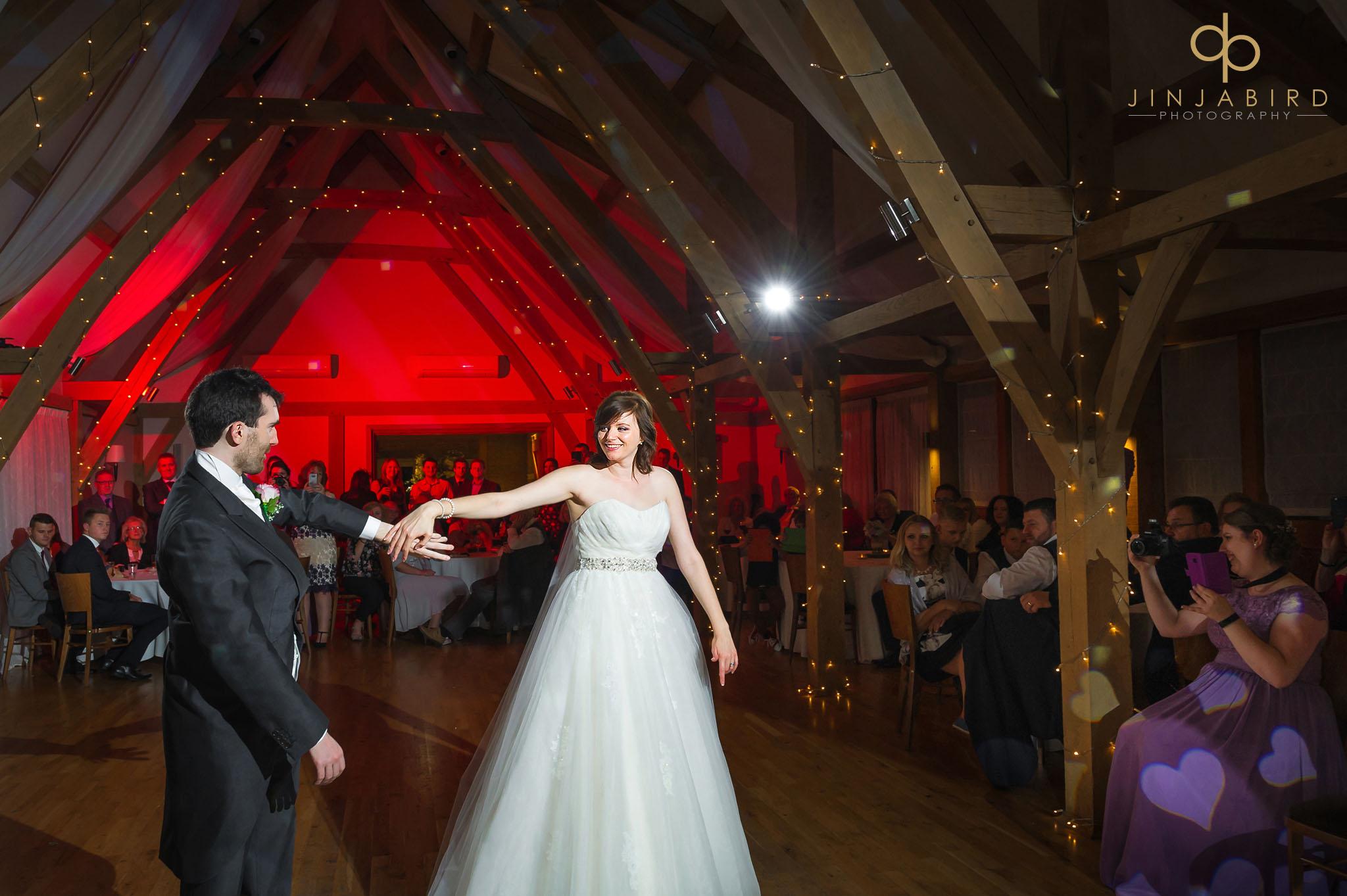 bride dancing with groom at bassmead