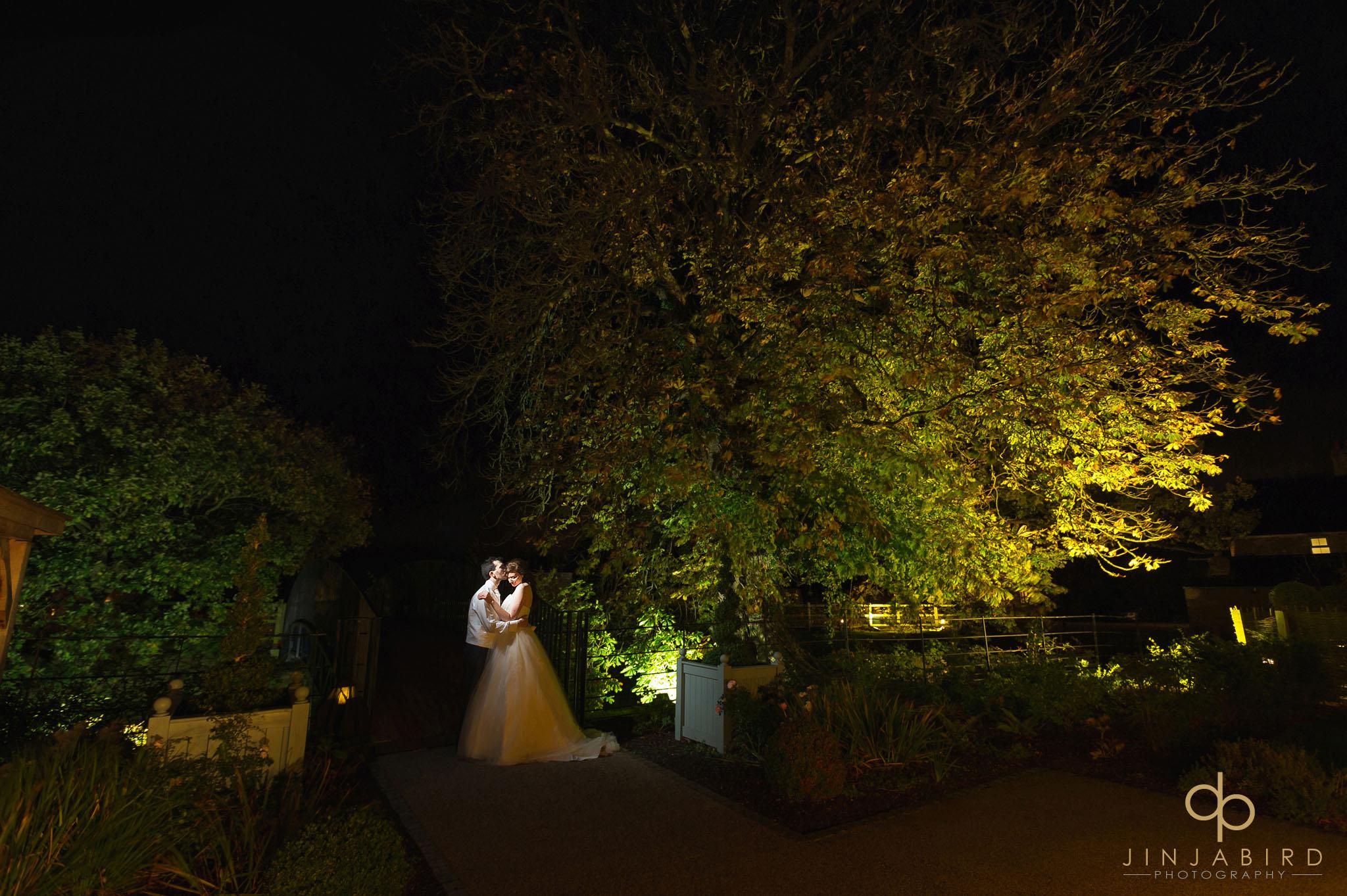 night time photo of bride and groom on bridge bassmead manor