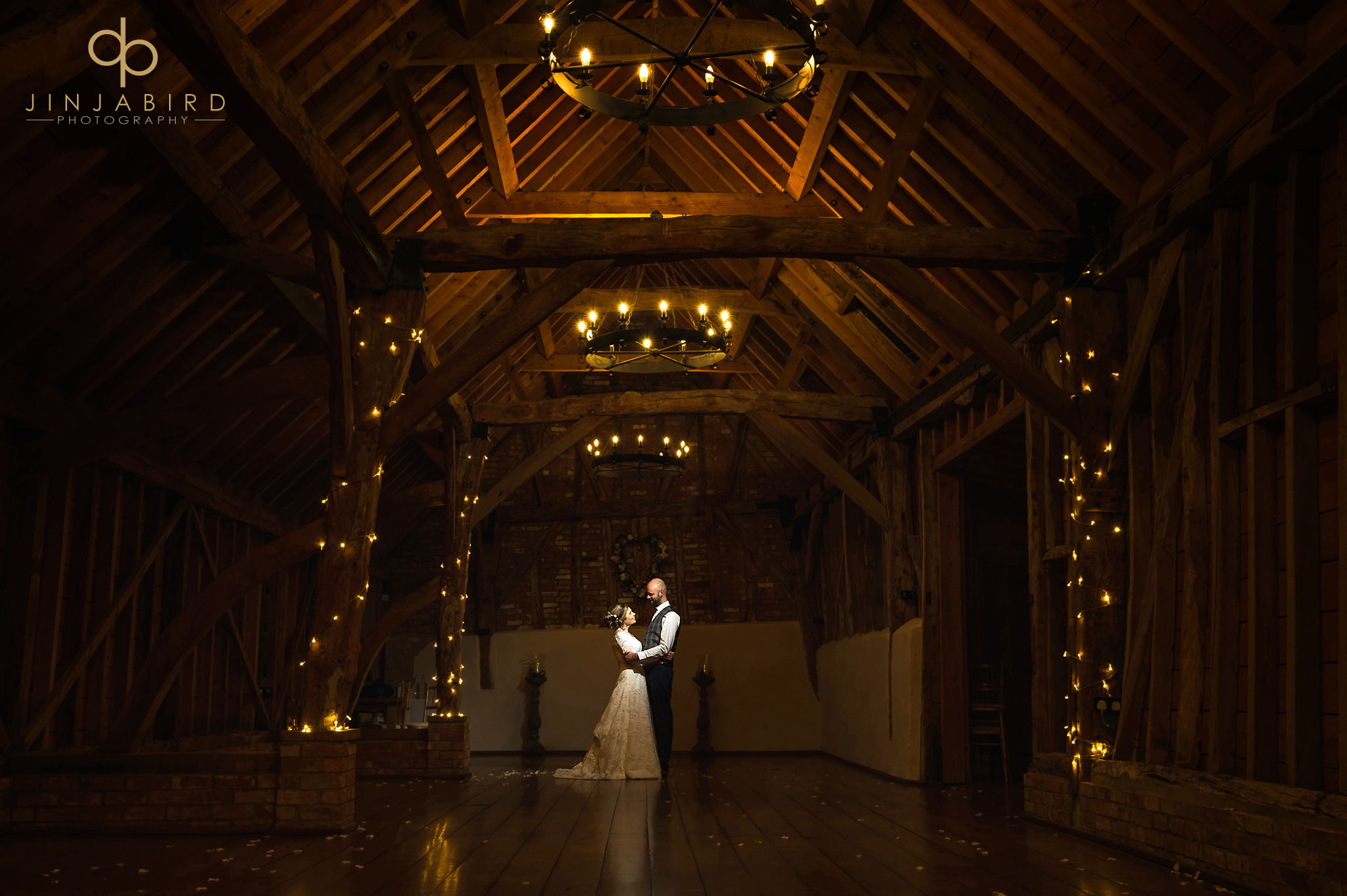 bride and groom in rickety barn at night bassmead manor