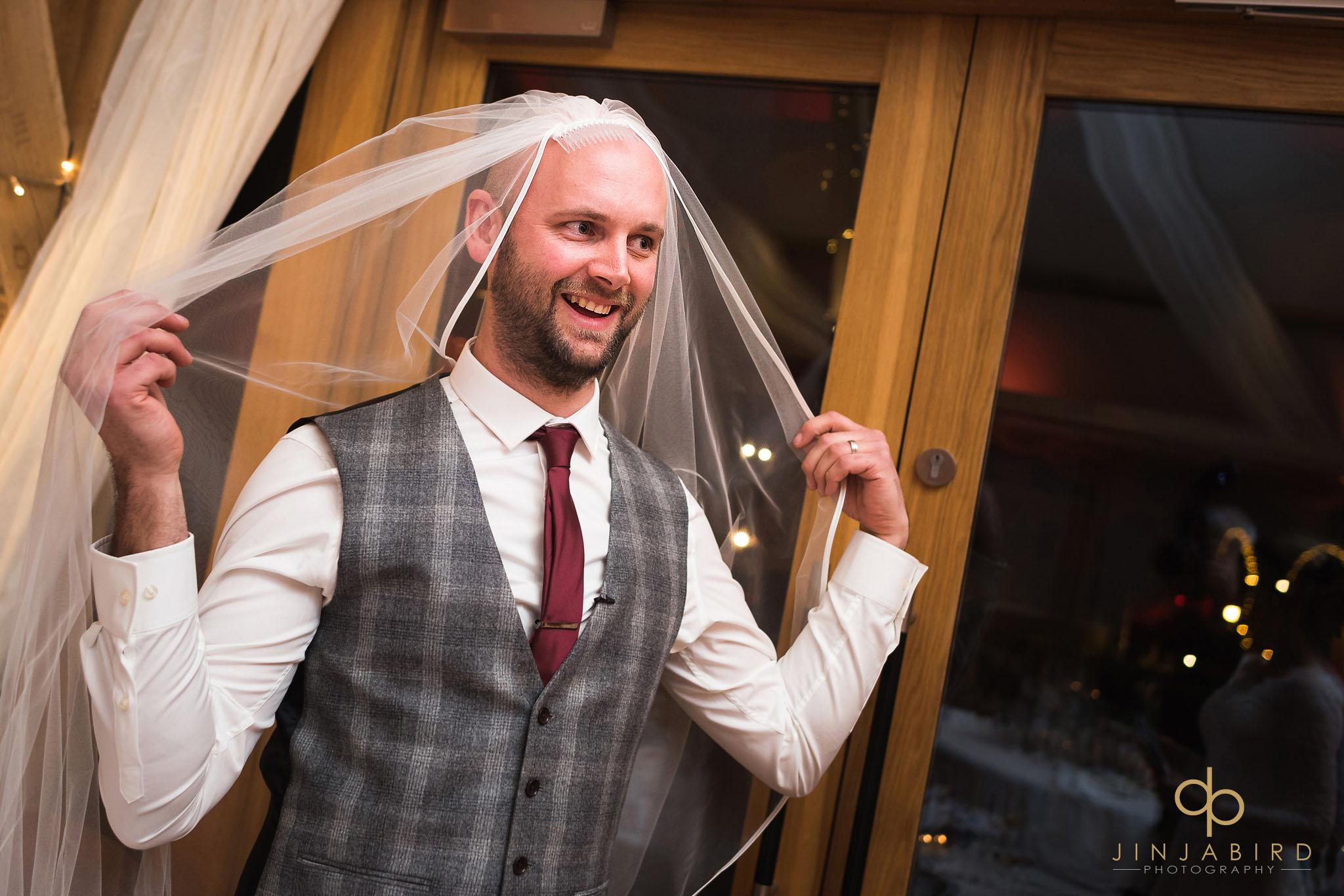 groom with veil on