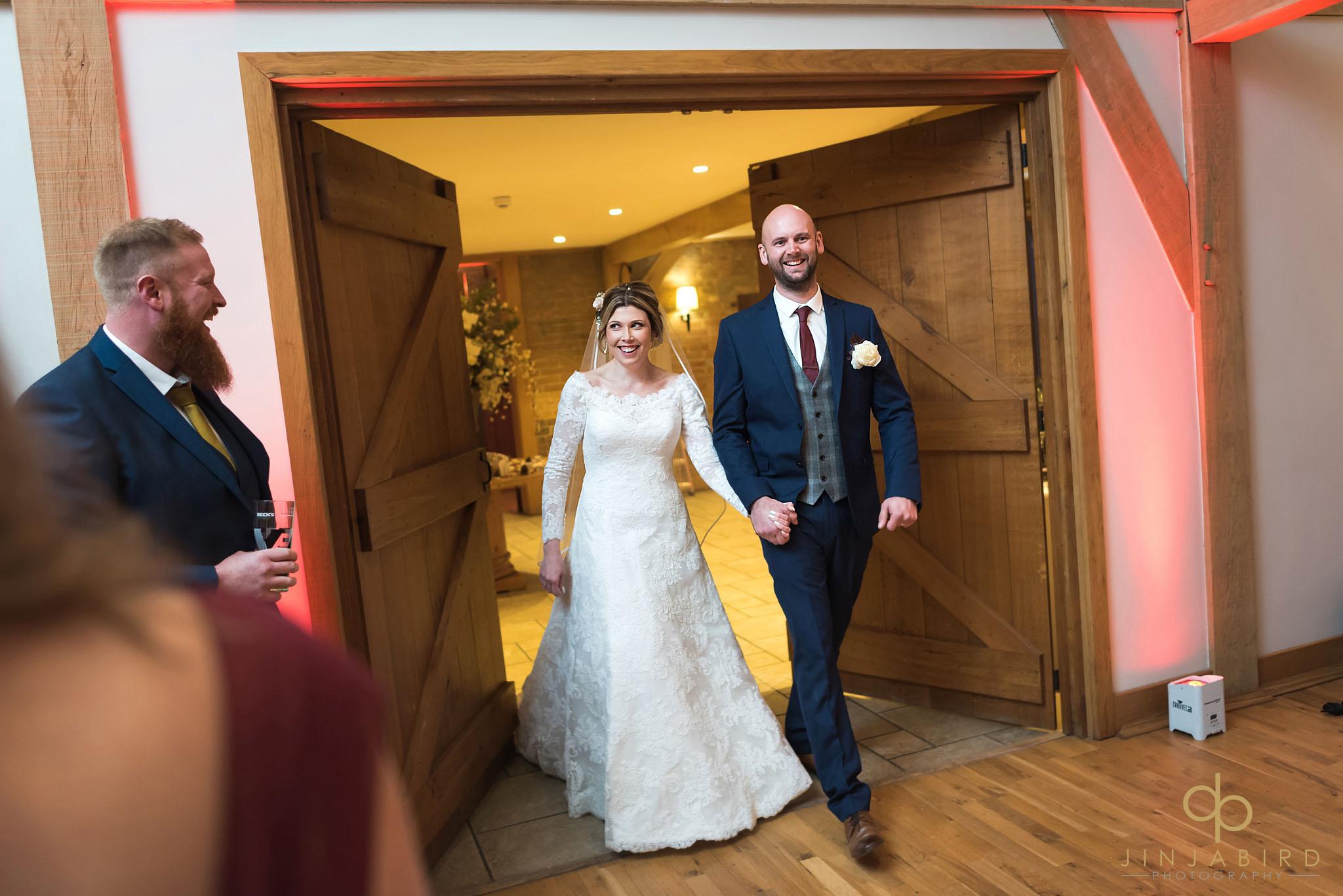 bride and groom enter wedding breakfast