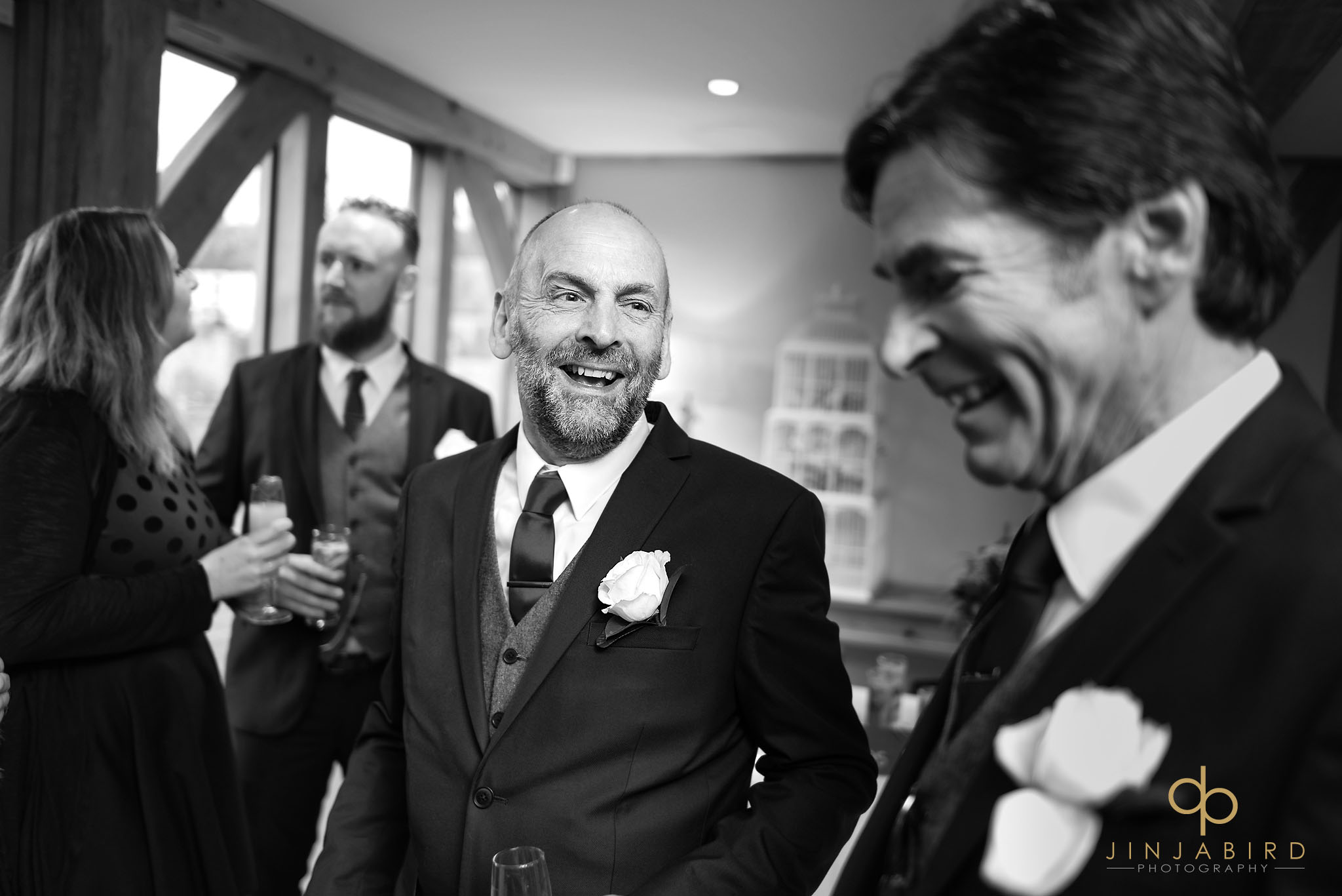 grooms father laughing
