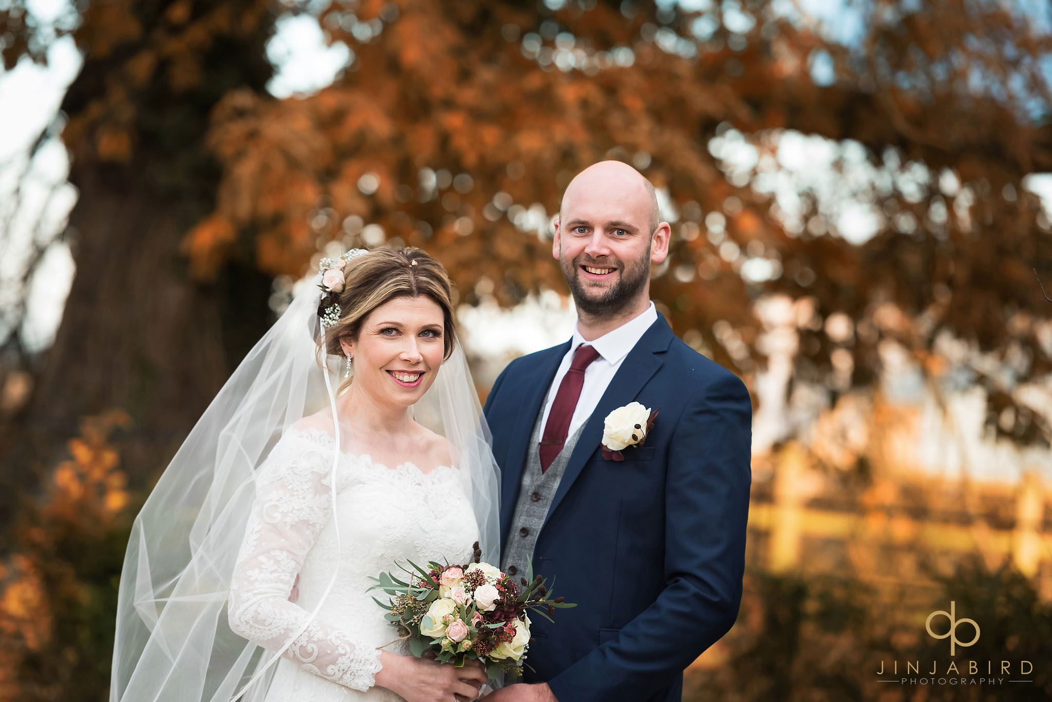 bride and groom with autumn colours in garden at bassmead