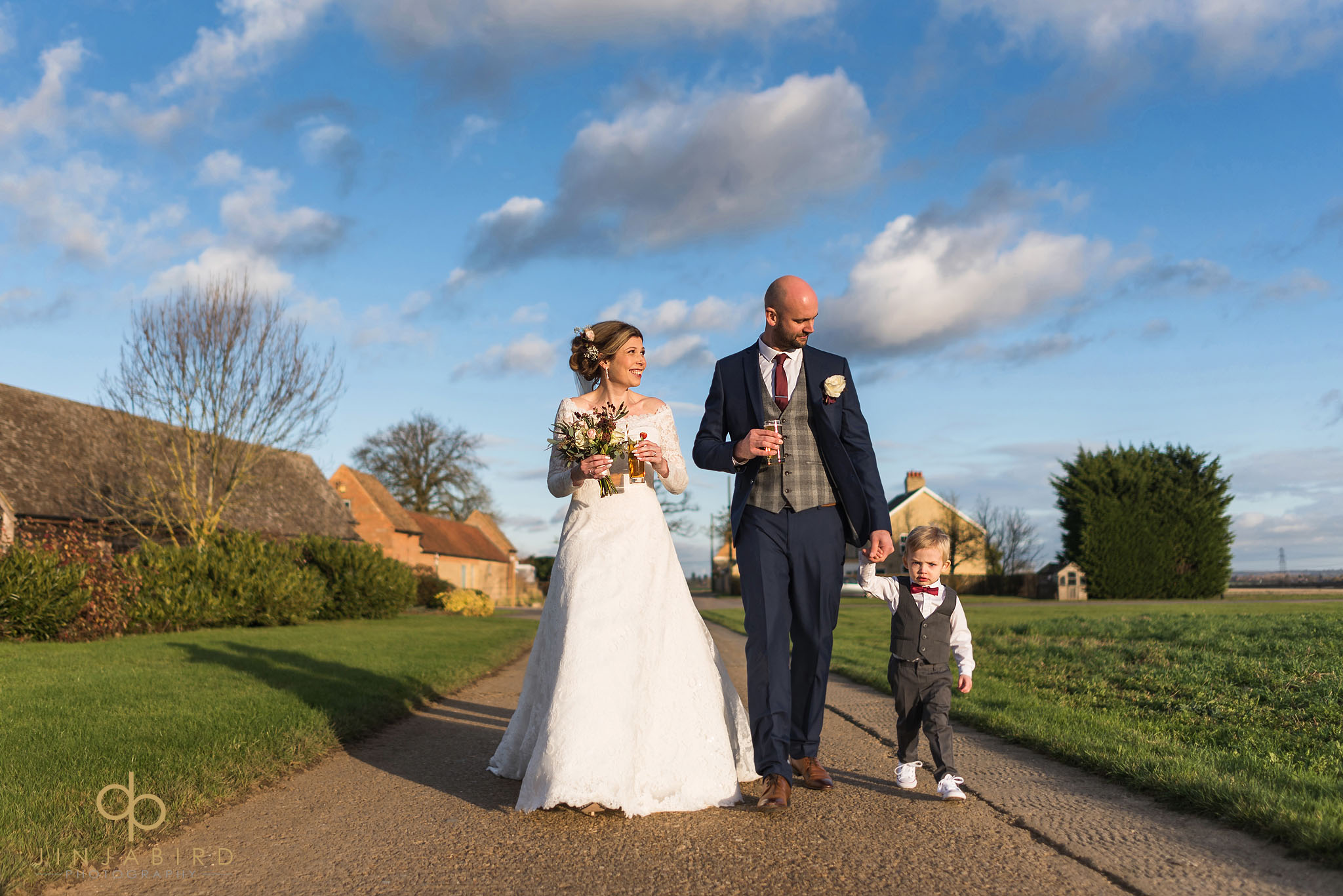 bride and groom walking on drive bassmead manor