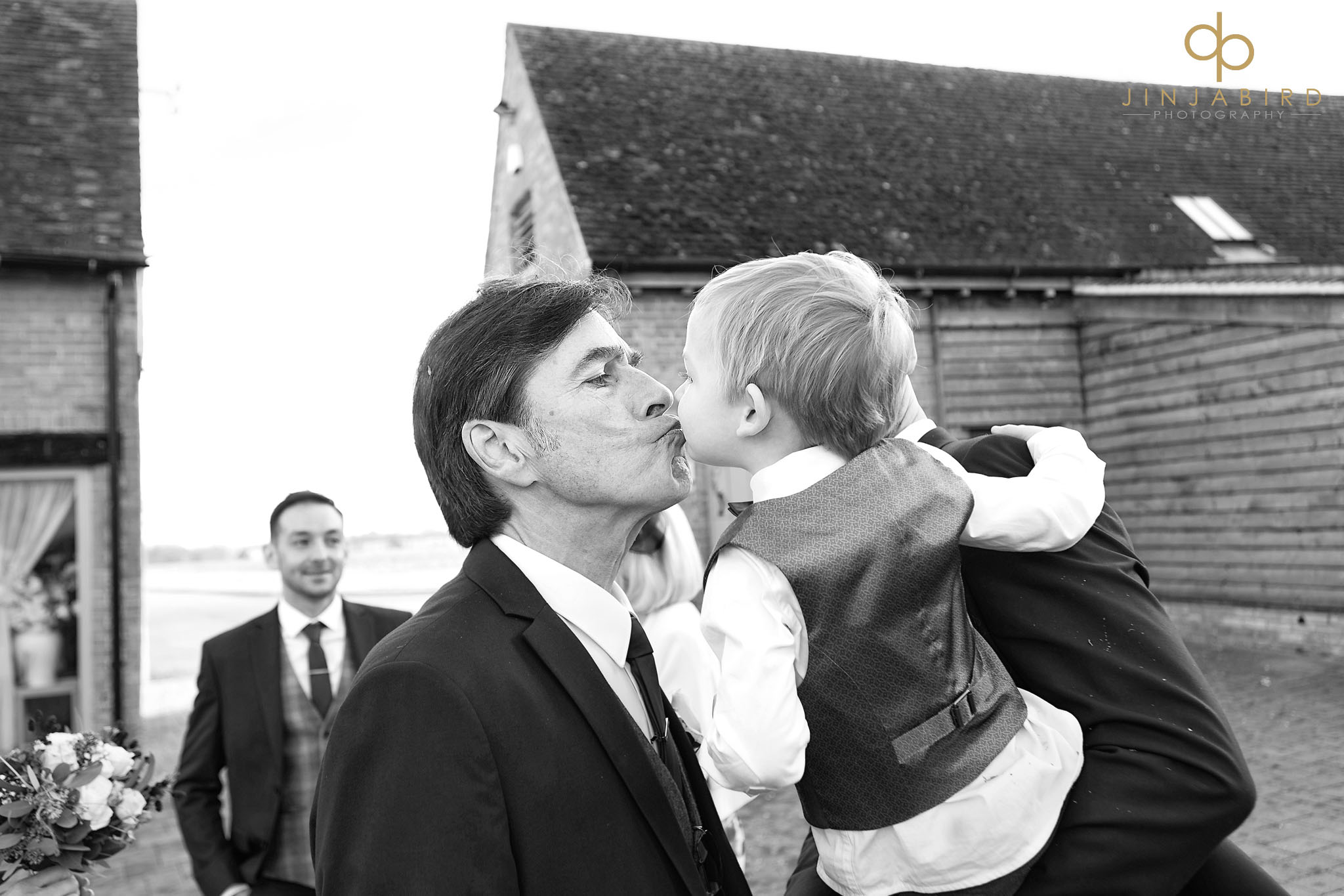 grandfather kisses pageboy
