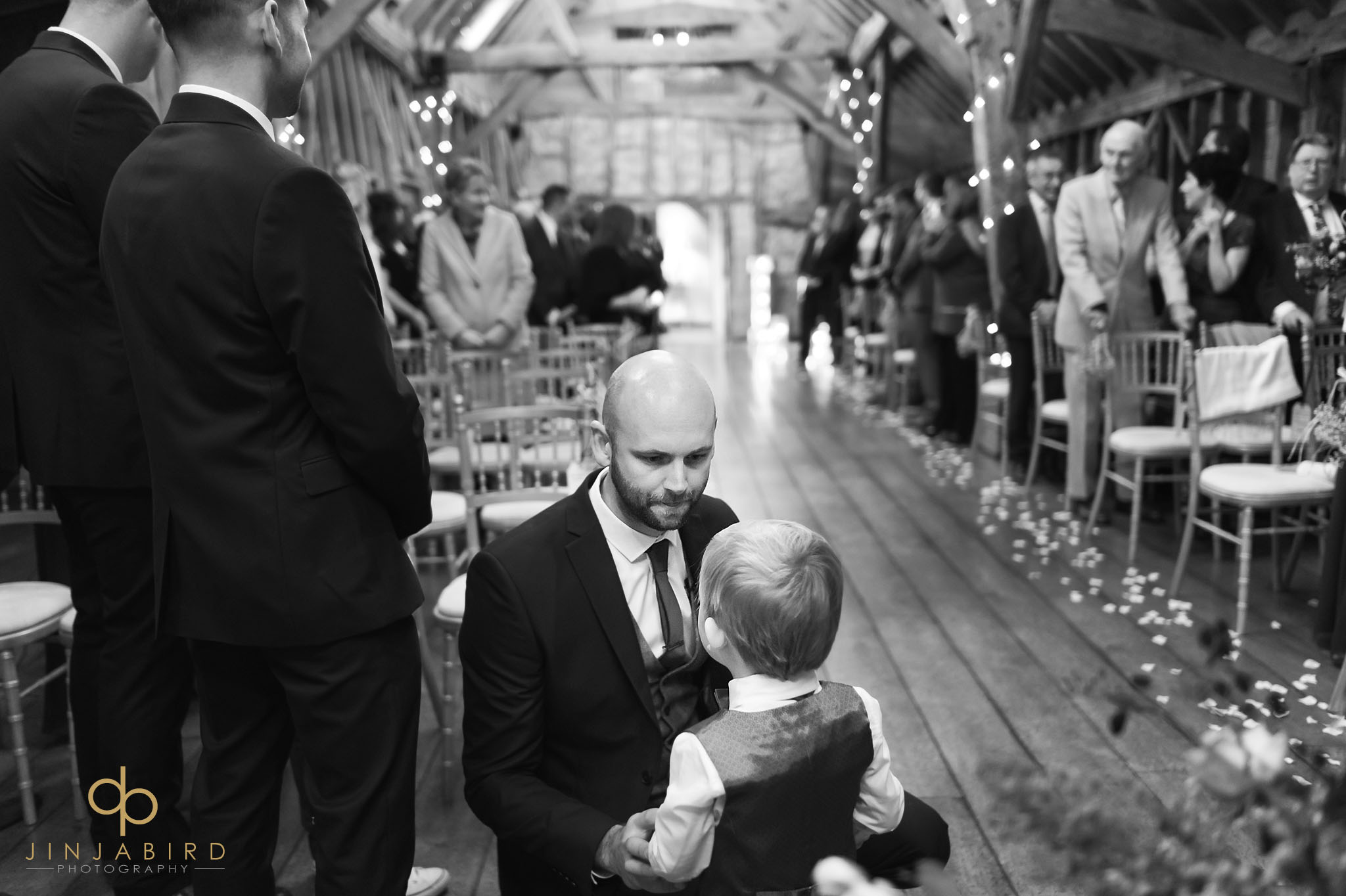 groom waiting with pageboy