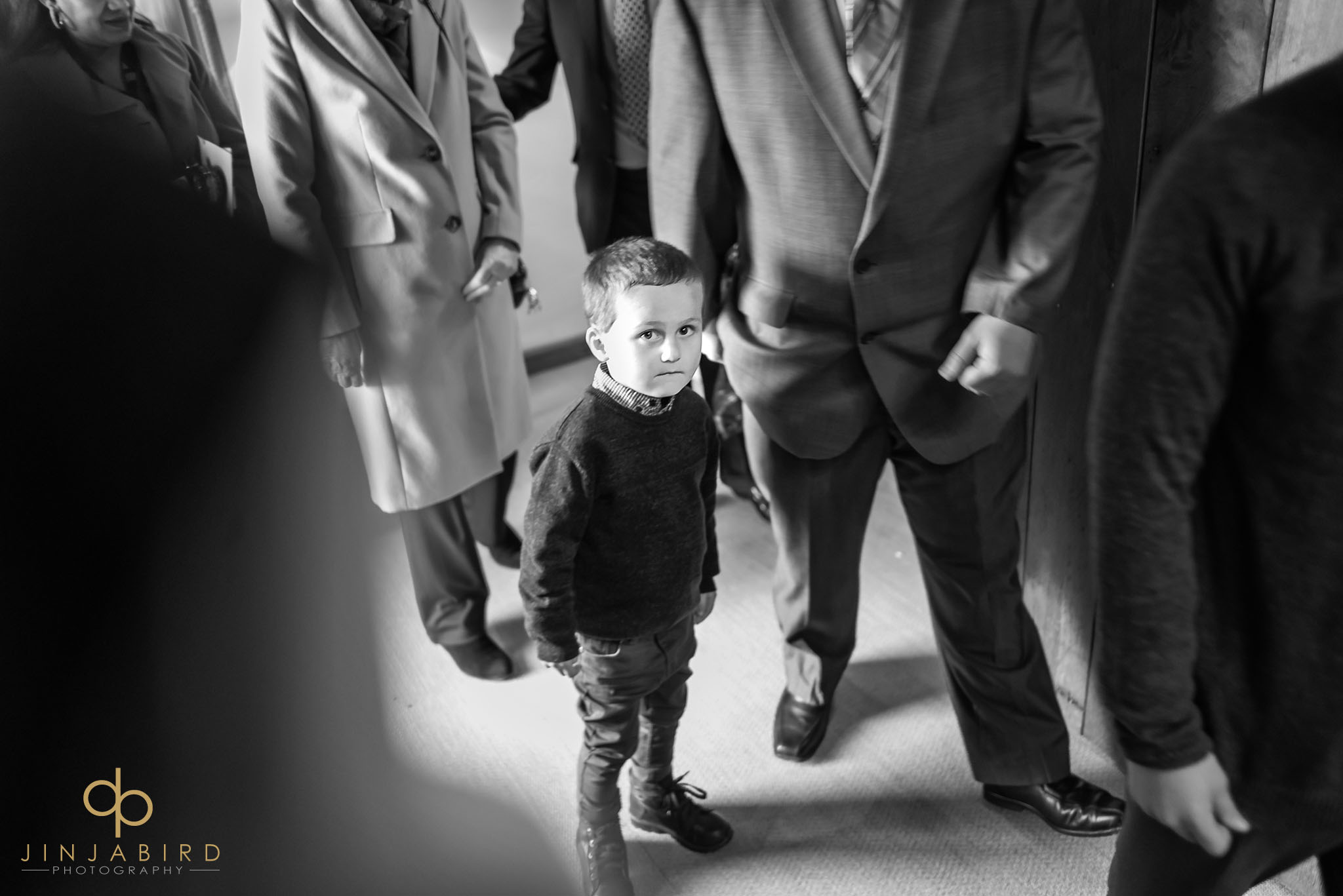 small boy looking at groom