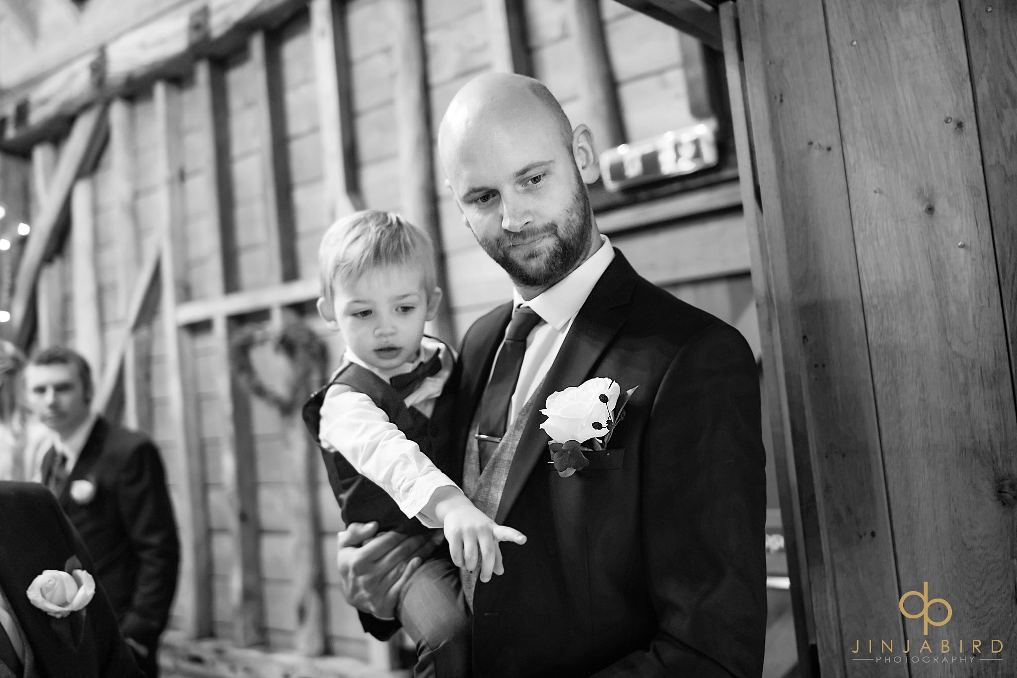 groom holding pageboy