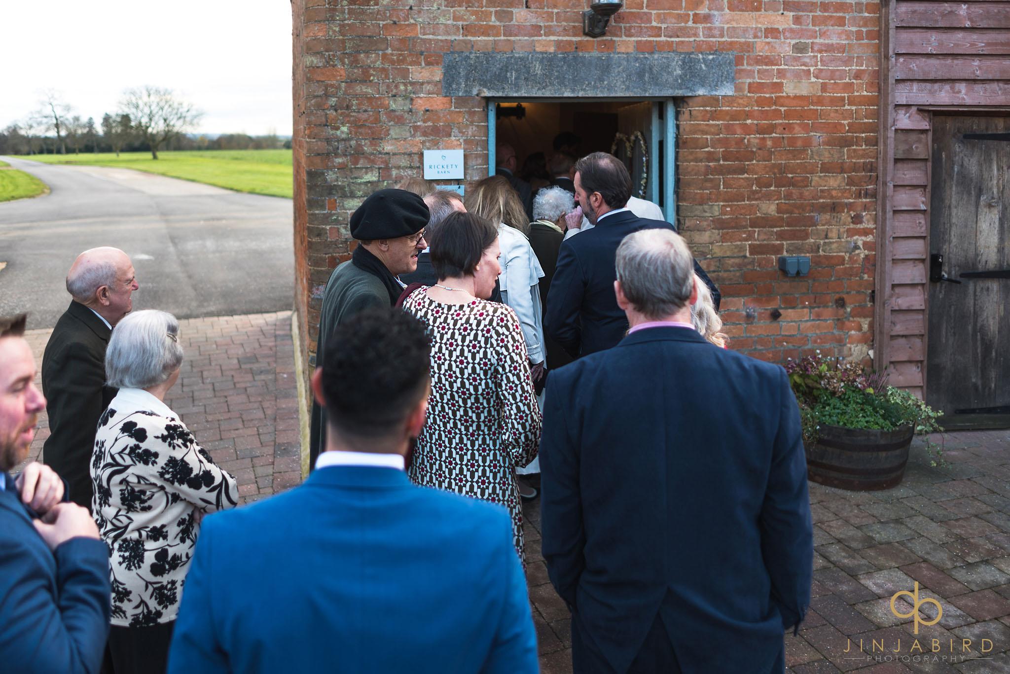 wedding guests entering ceremony