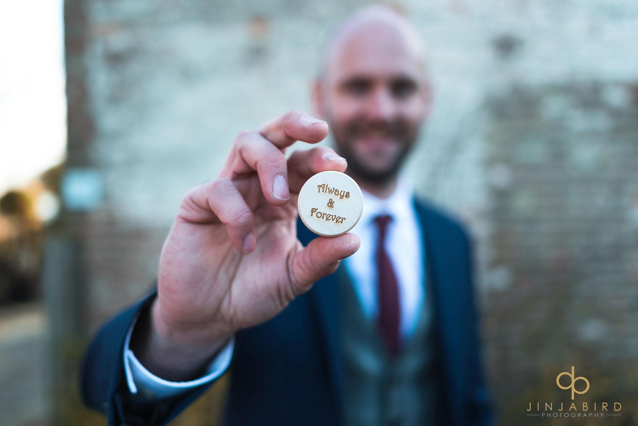 groom holding rings