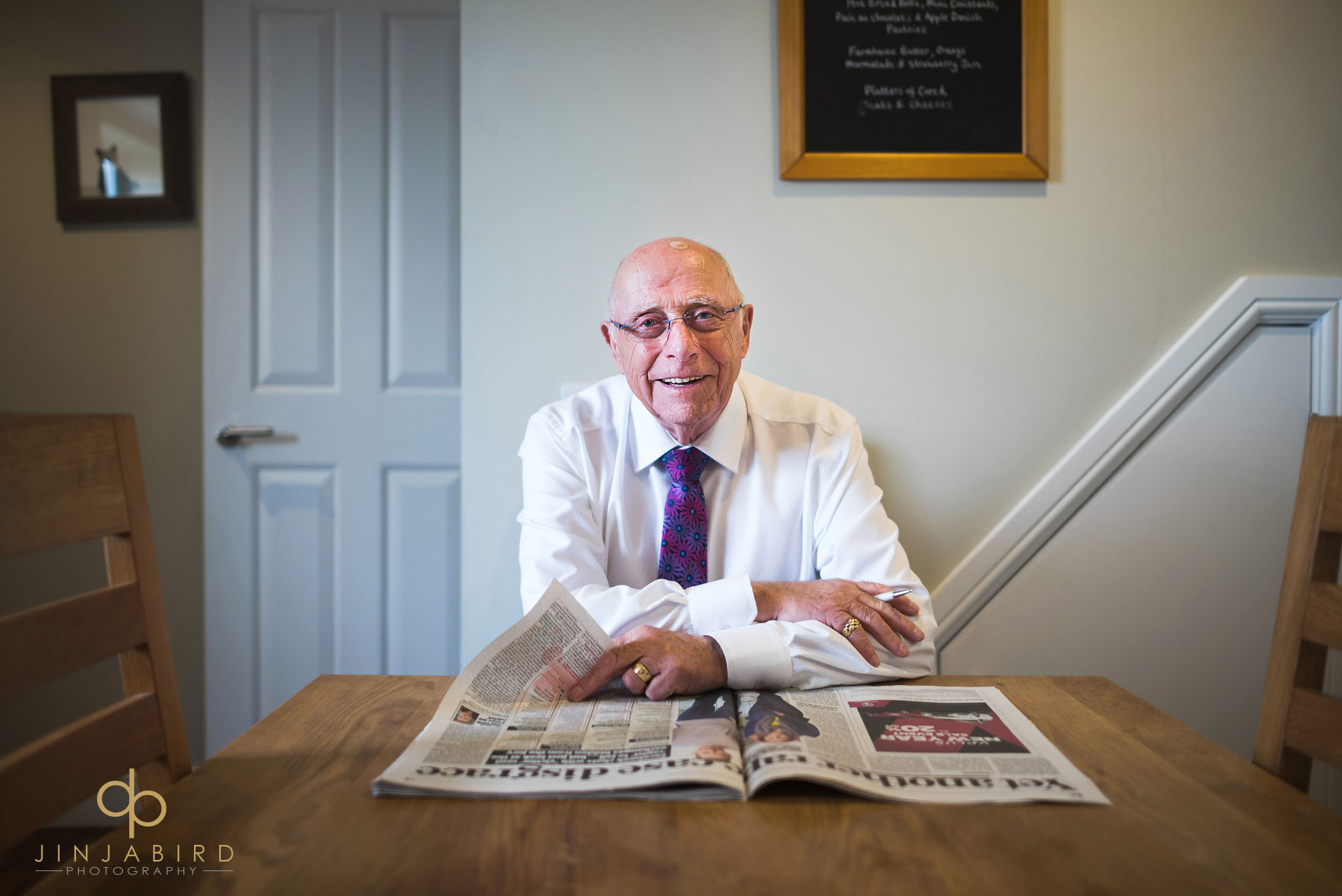 grandfather reading newspaper