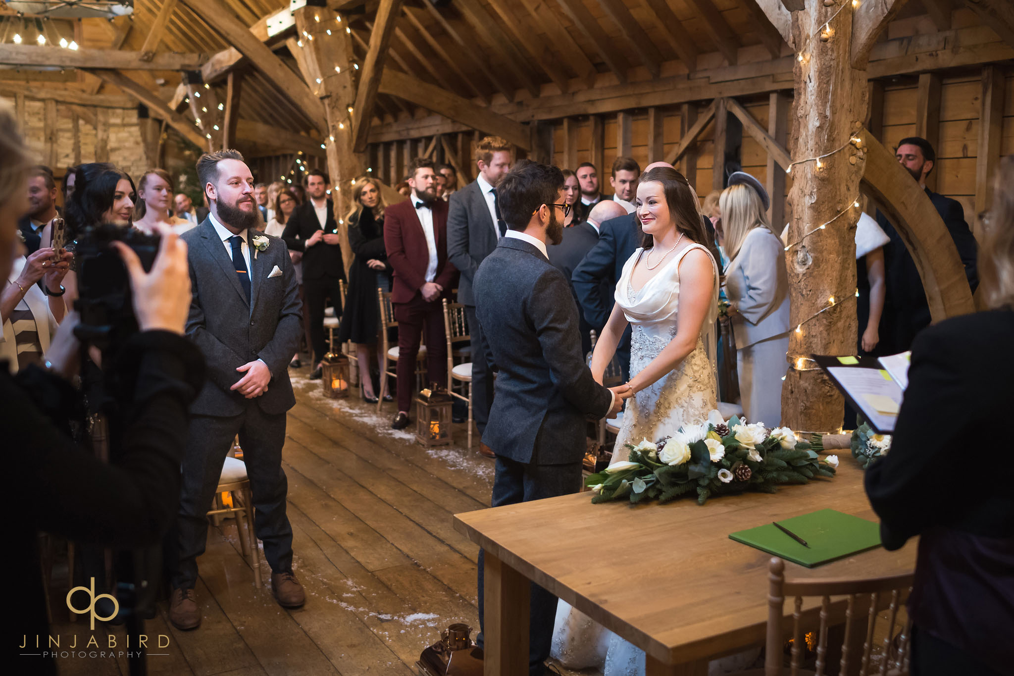 bride and groom in rickety barn