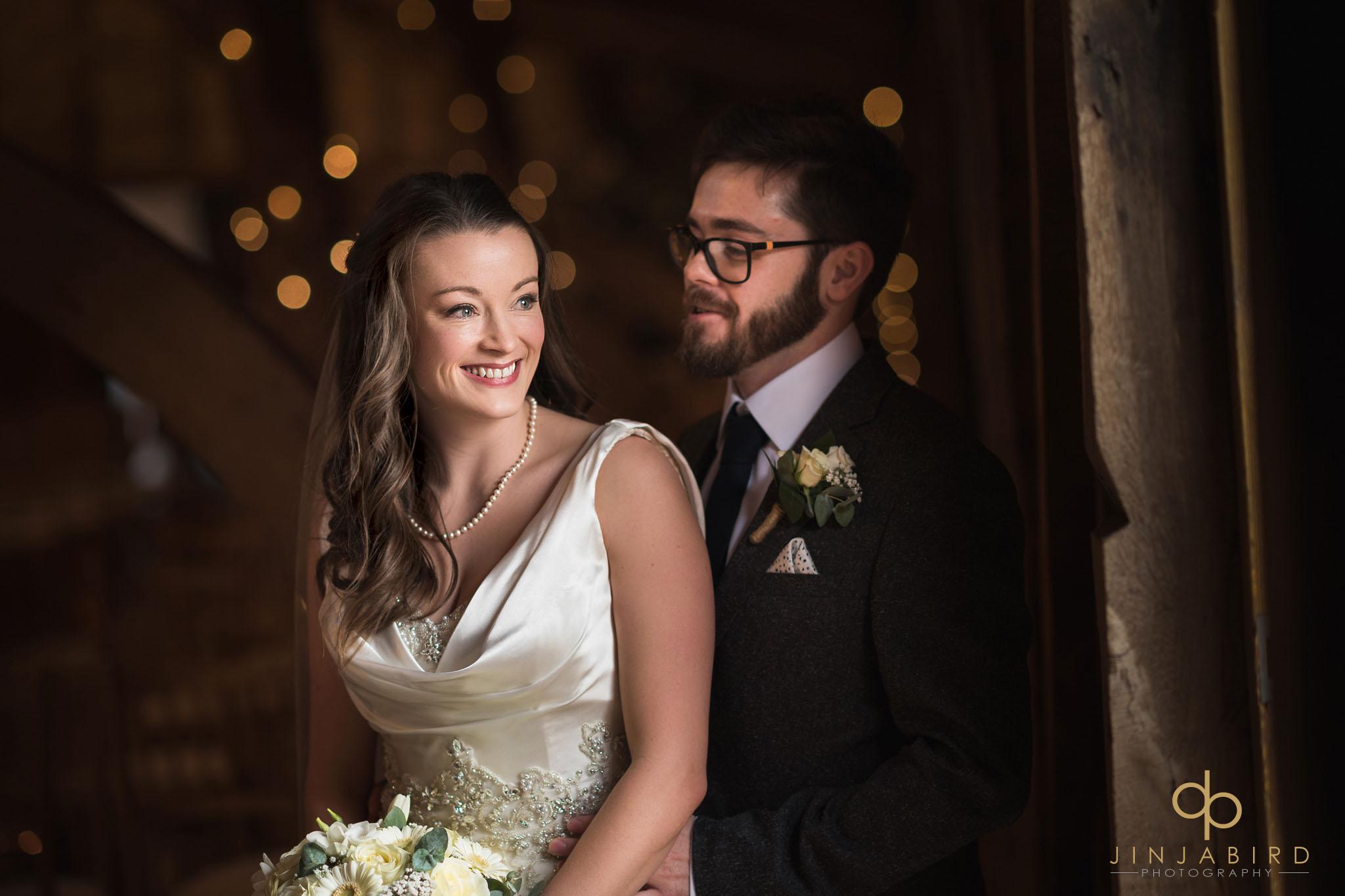 bride with groom inside rickety barn