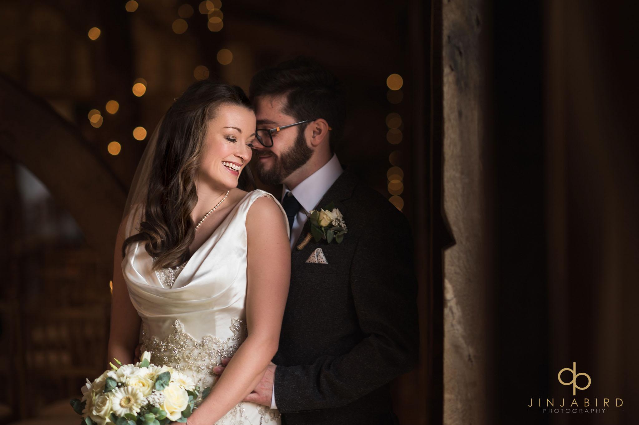 groom hugging bride bassmead manor