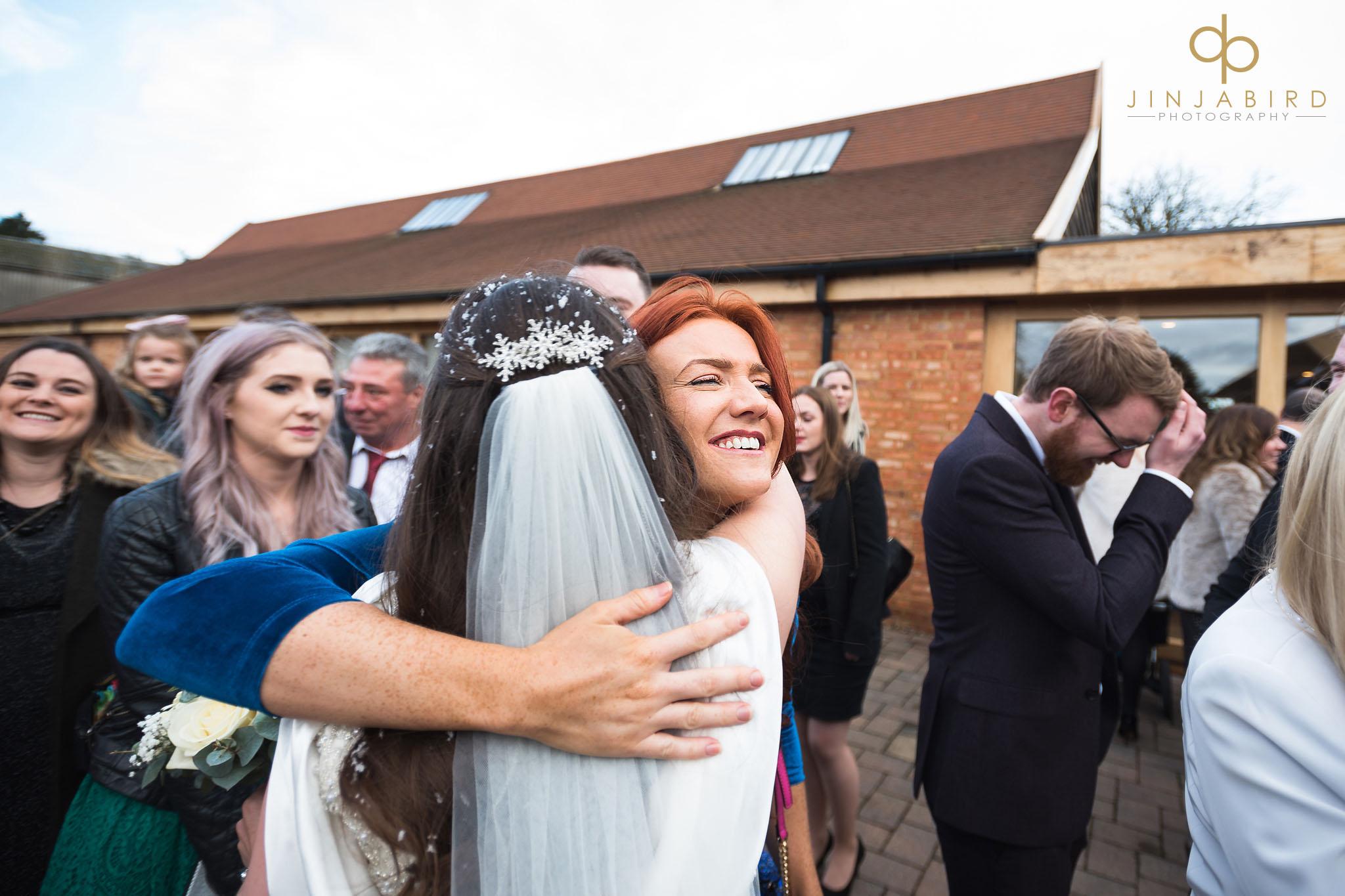 wedding guest squeezes bride