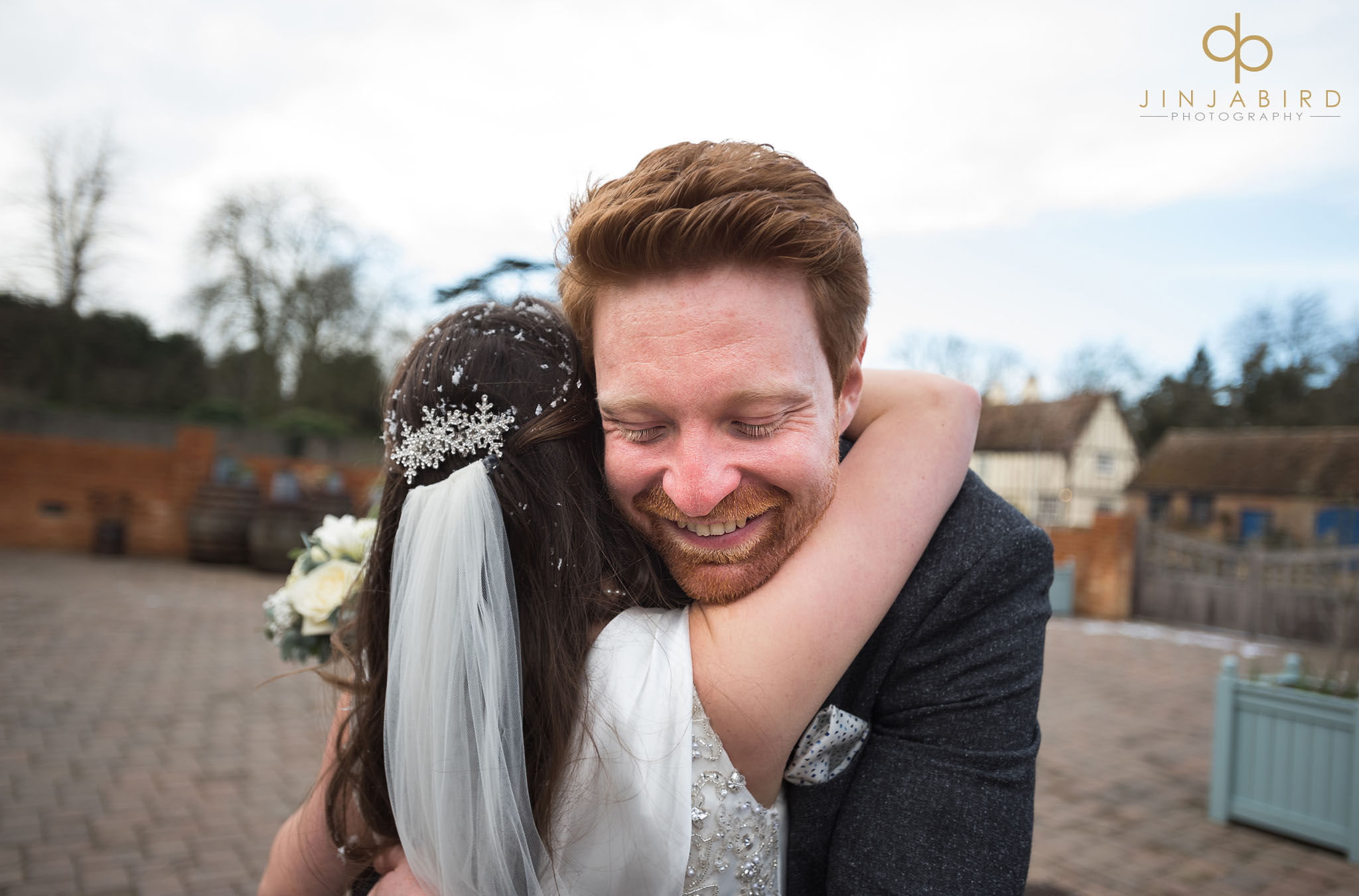 guest with bride hugging